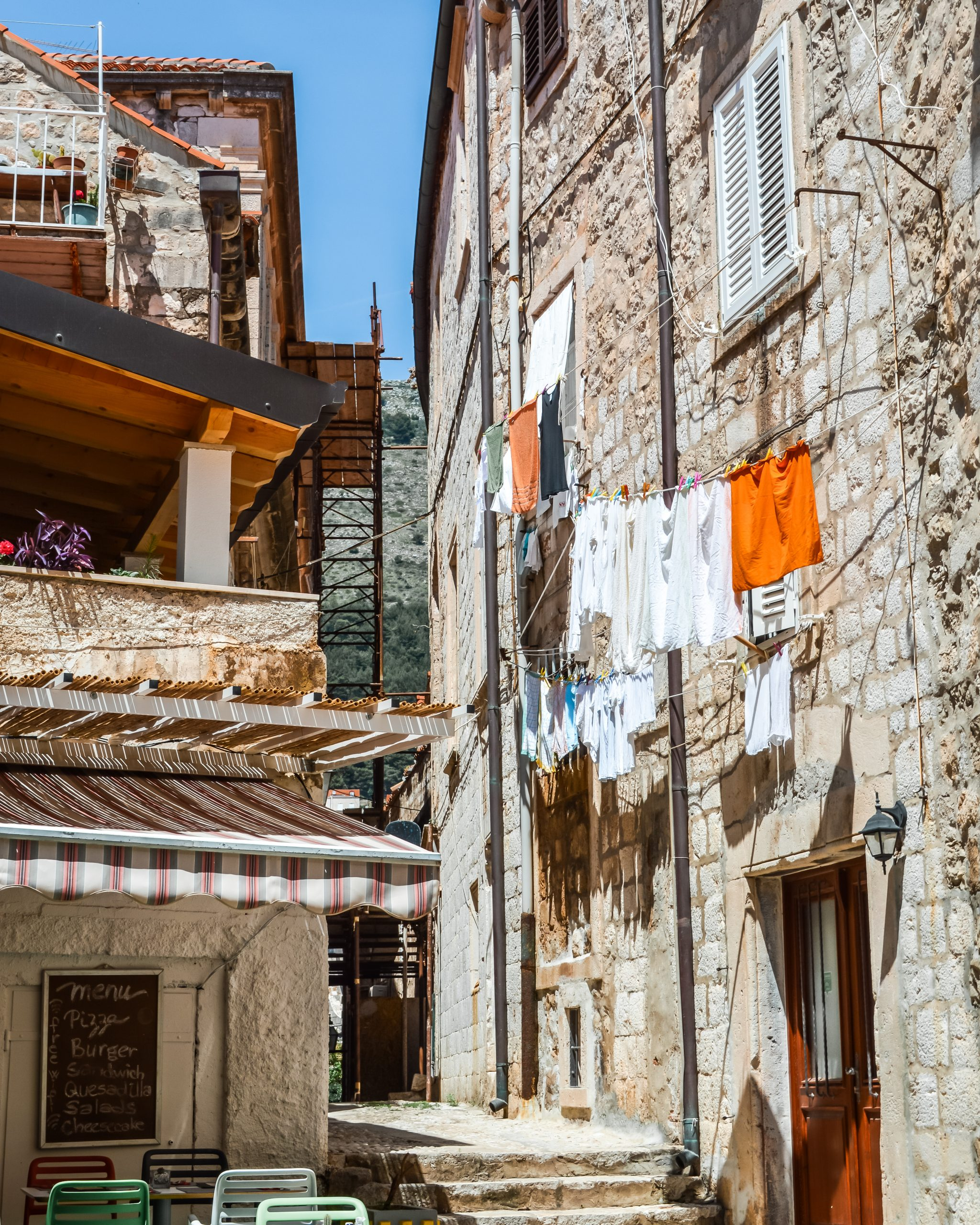 hanging laundry and cobblestone streets in dubrovnik, croatia