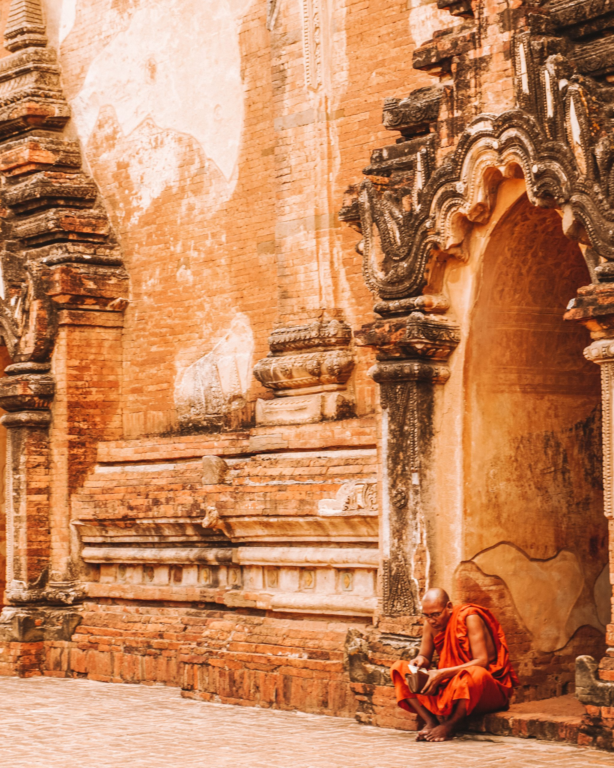monk at temple in bagan myanmar travel itinerary