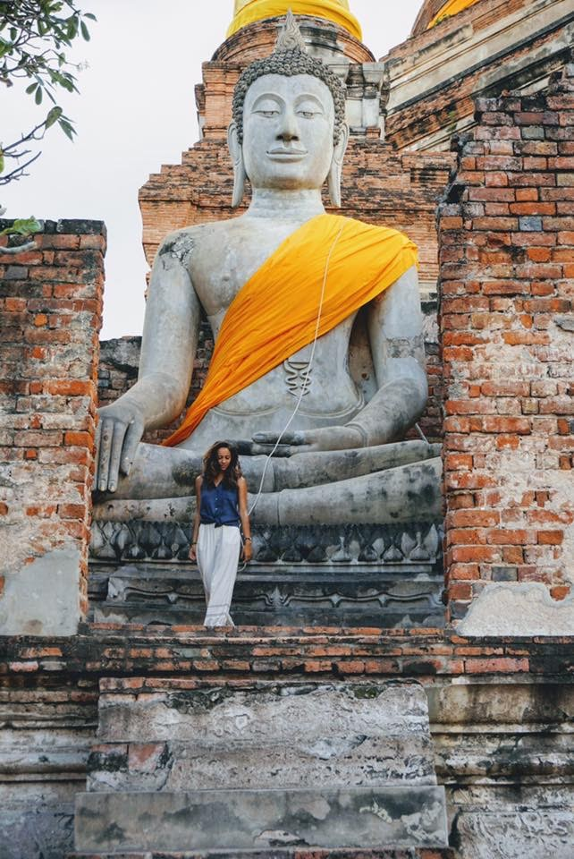 girl in front of large buddha at ayutthaya temples