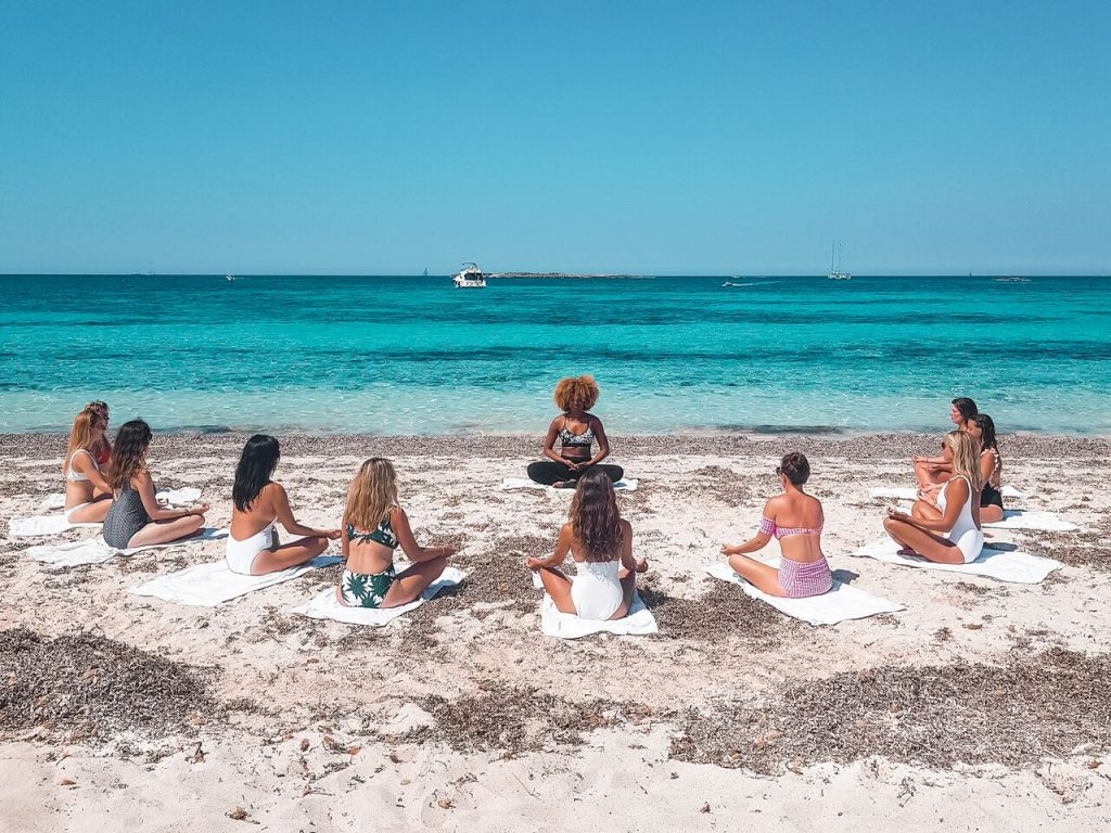 Morning Yoga on the beach in Mallorca, Spain