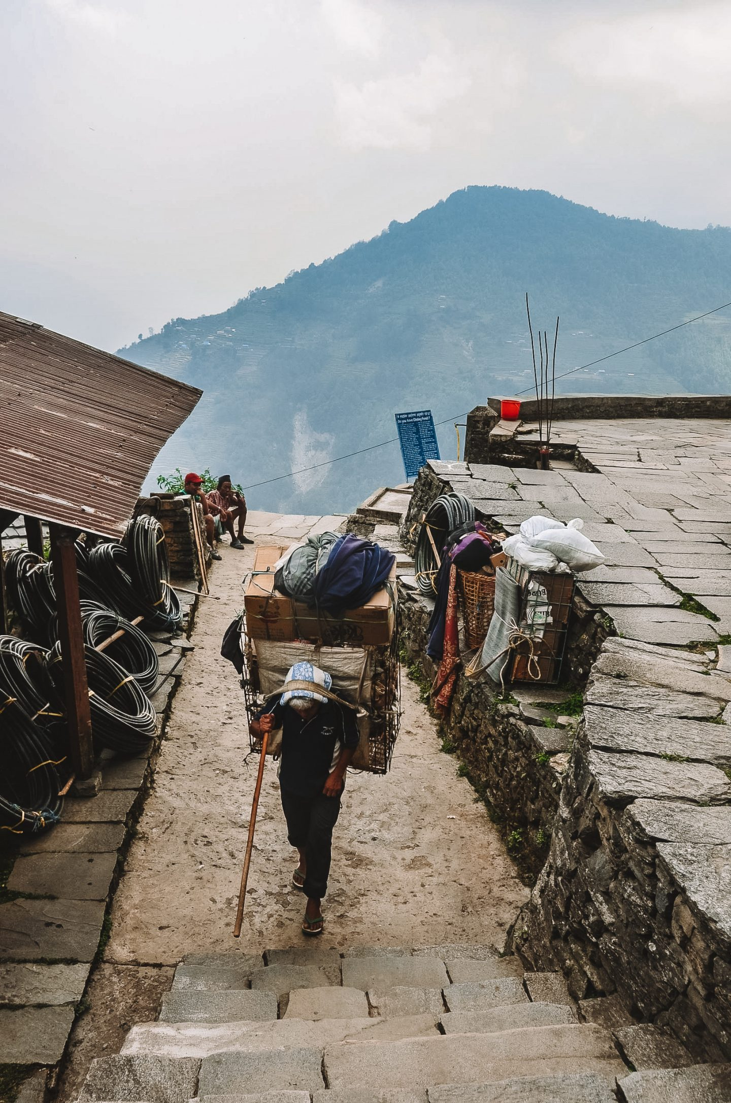man carrying gear on the annapurna base camp trek