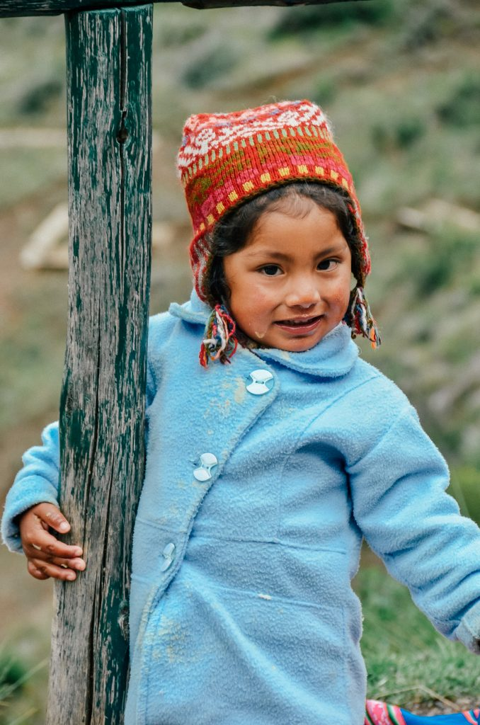Why you need to visit Peru today - young kid in winter hat