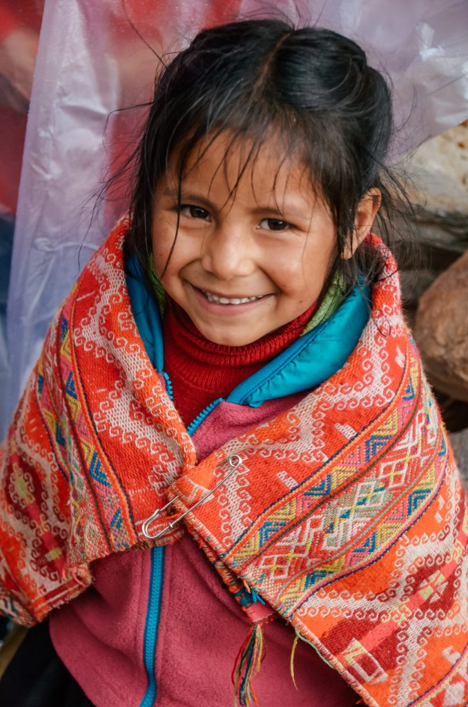 Why you need to visit Peru today - beautiful young girl in local attire
