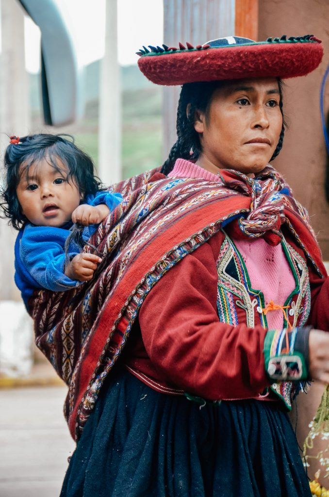 Why you need to visit Peru today - Adorable child with mom