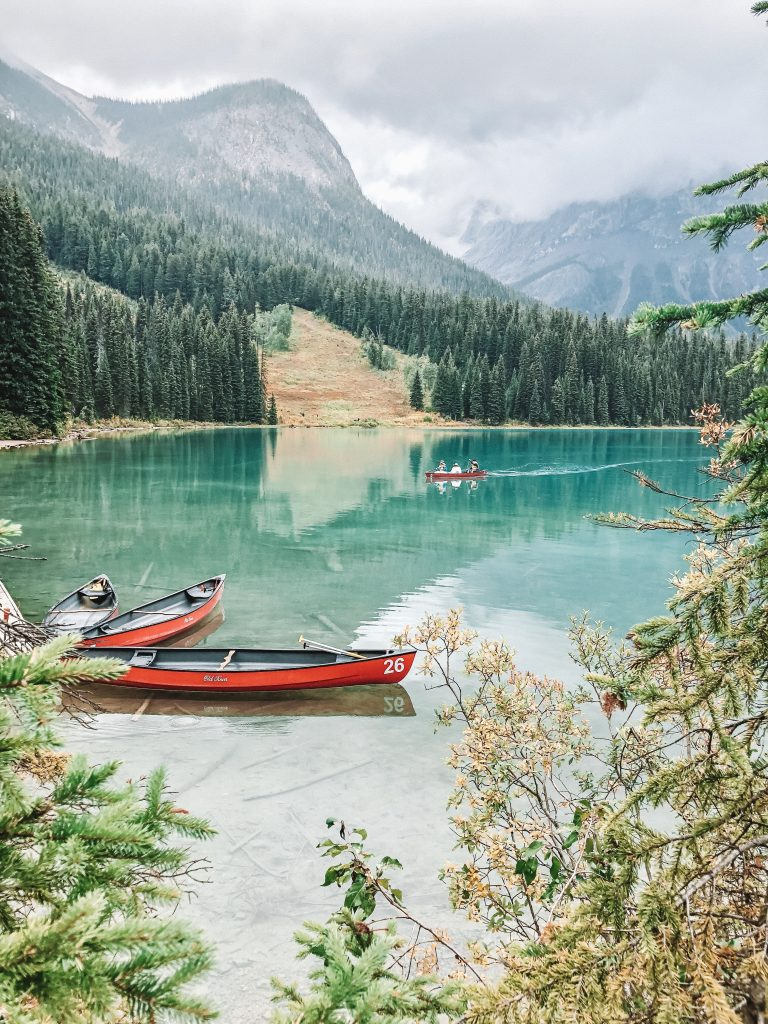 red boat on emerald lake canada