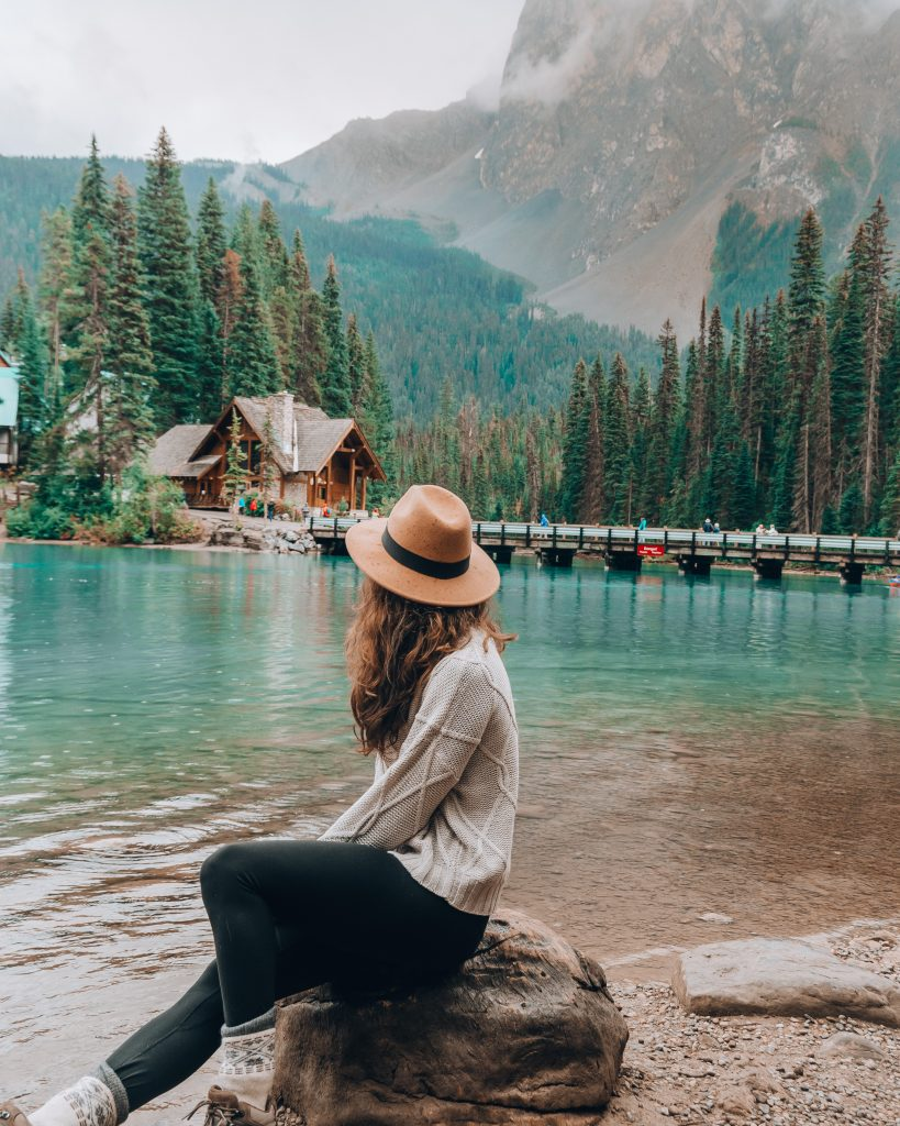 girl in hat at emerald lake