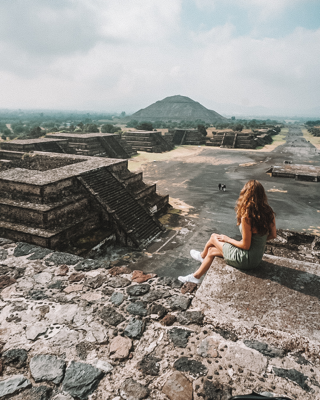 girl sitting at Teotihuacan Pyramids