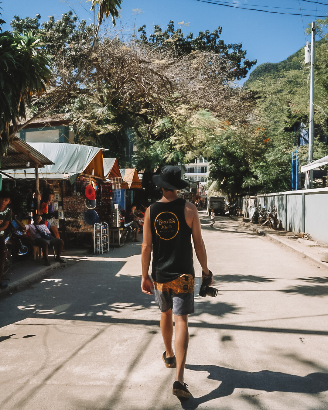guy exploring el nido town