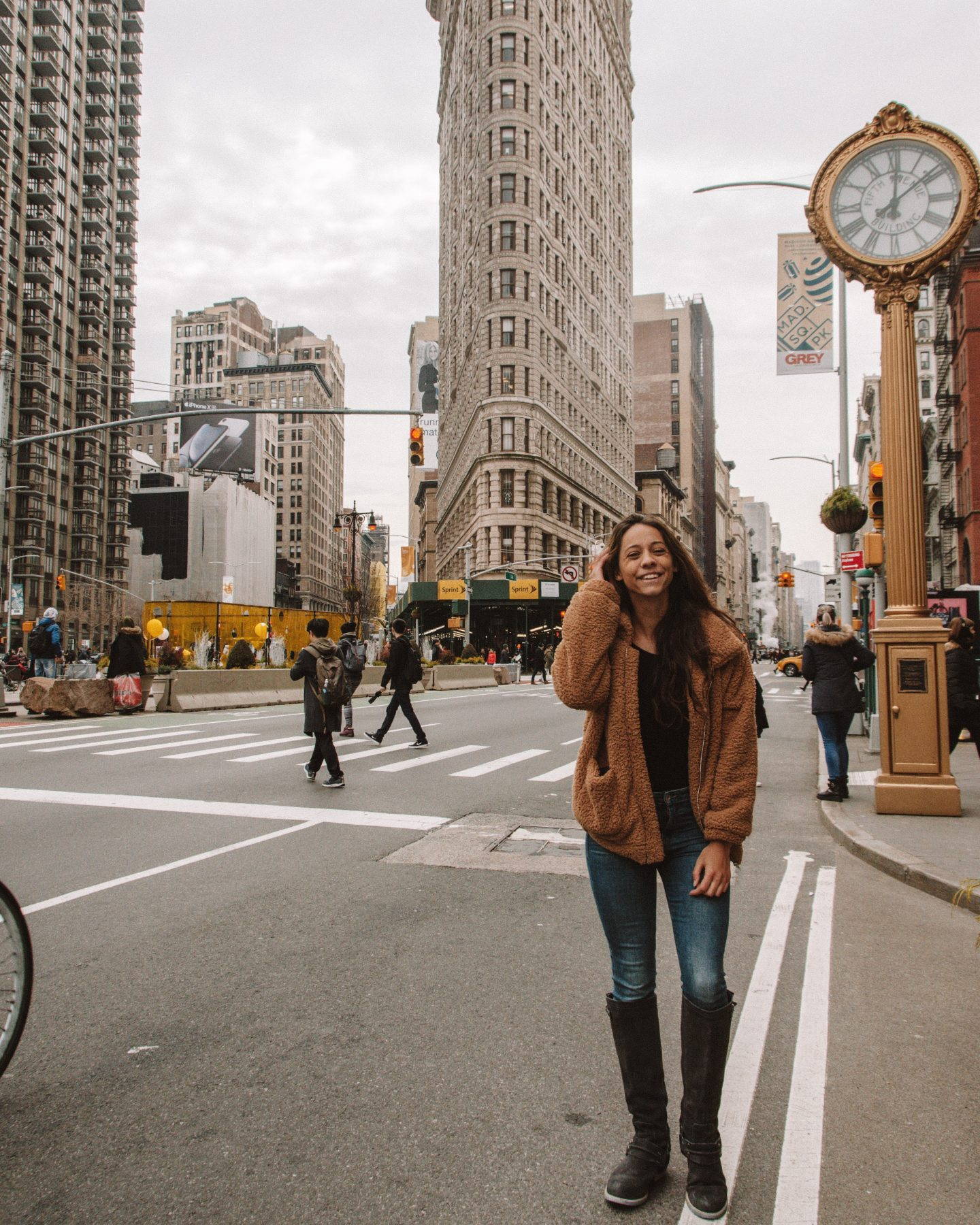 Girl posing in front of Flatiron Building in NYC