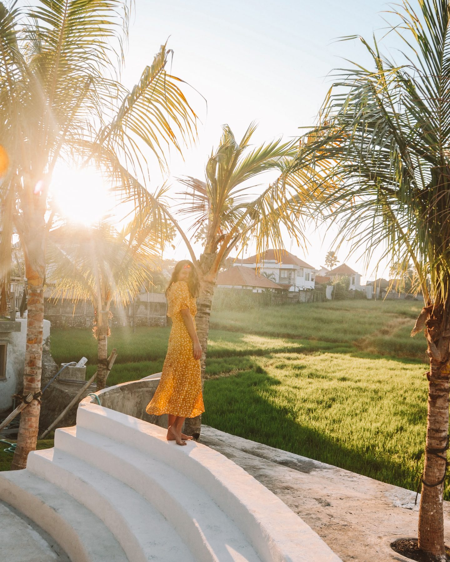 girl in yellow dress at sunrise in canggu bali