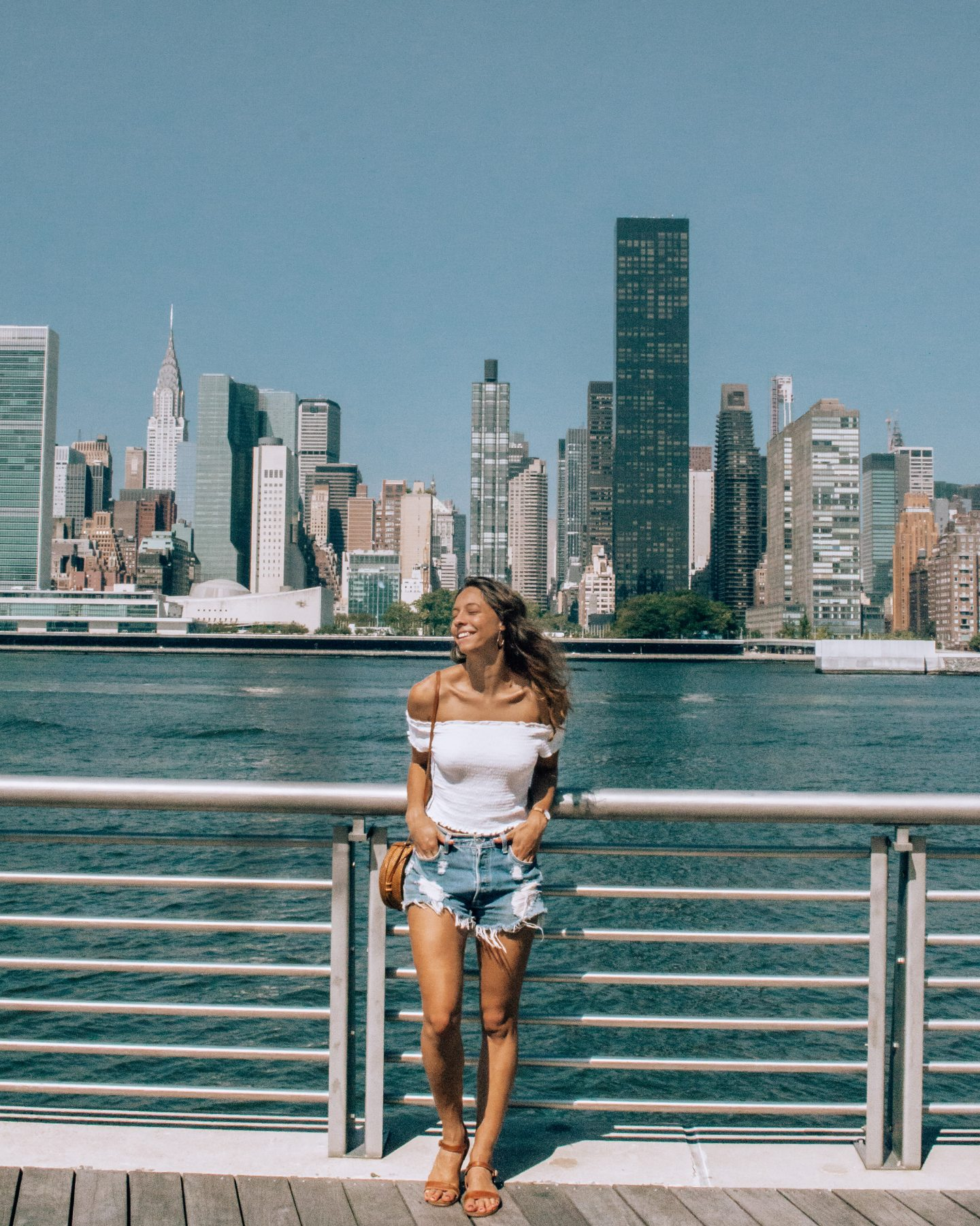 Girl in front of NY skyline shot from Long Island City