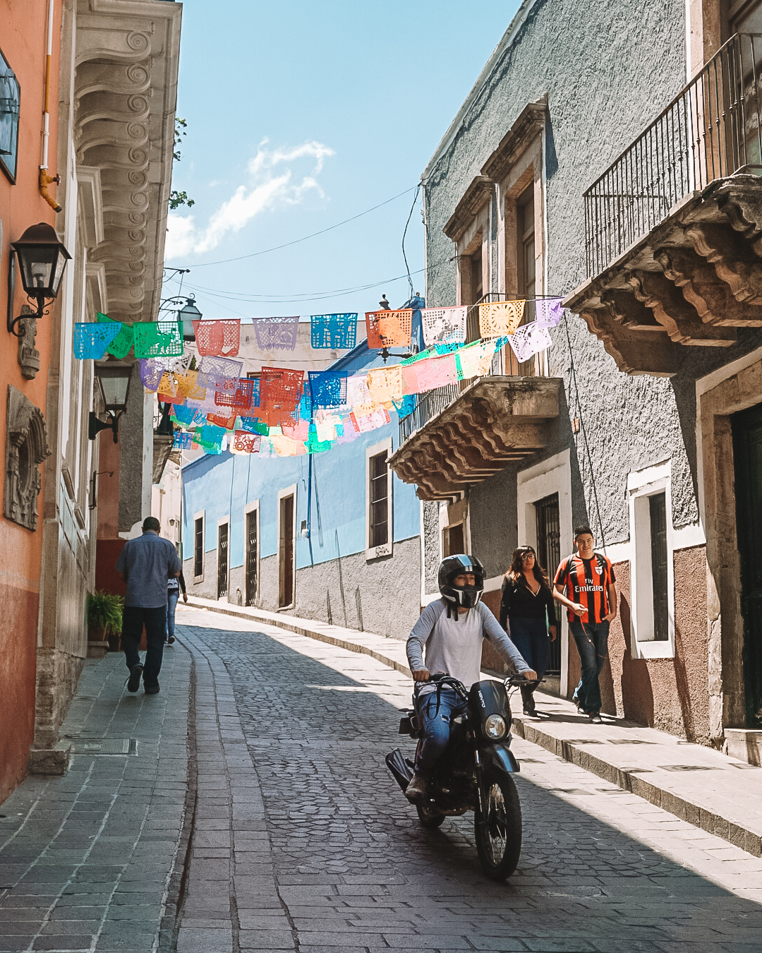 Colorful street with flags in Guanajuato, Mexico