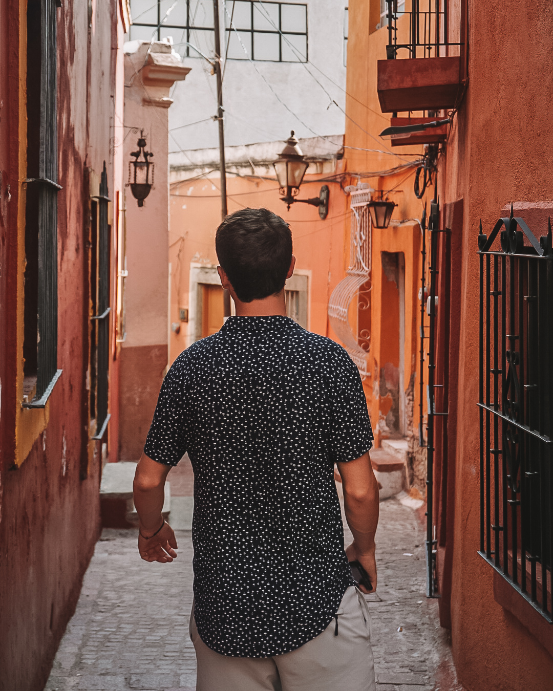 Man walking through Colorful streets in Guanajuato Mexico