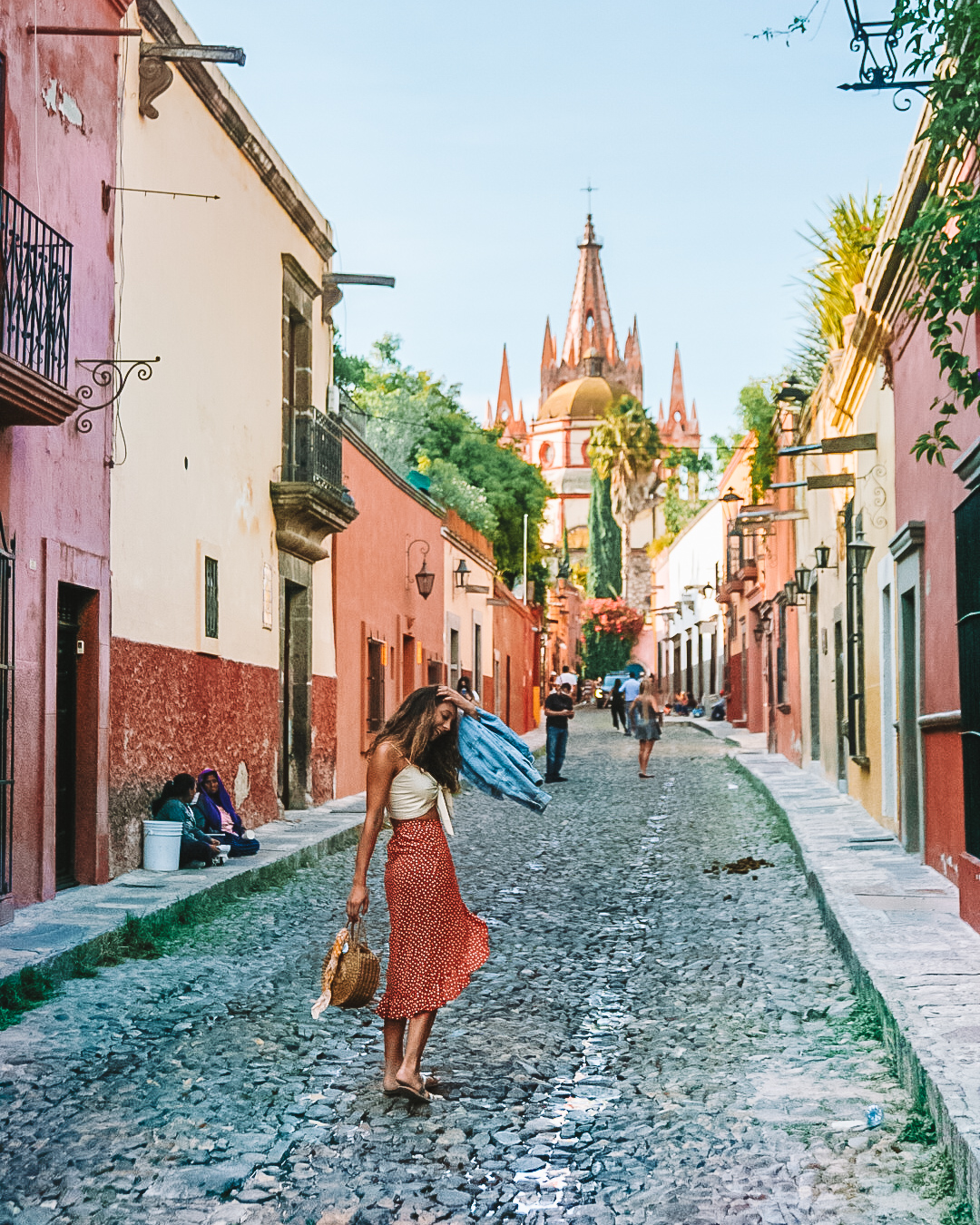Girl in orange skirt on colorful street in mexico