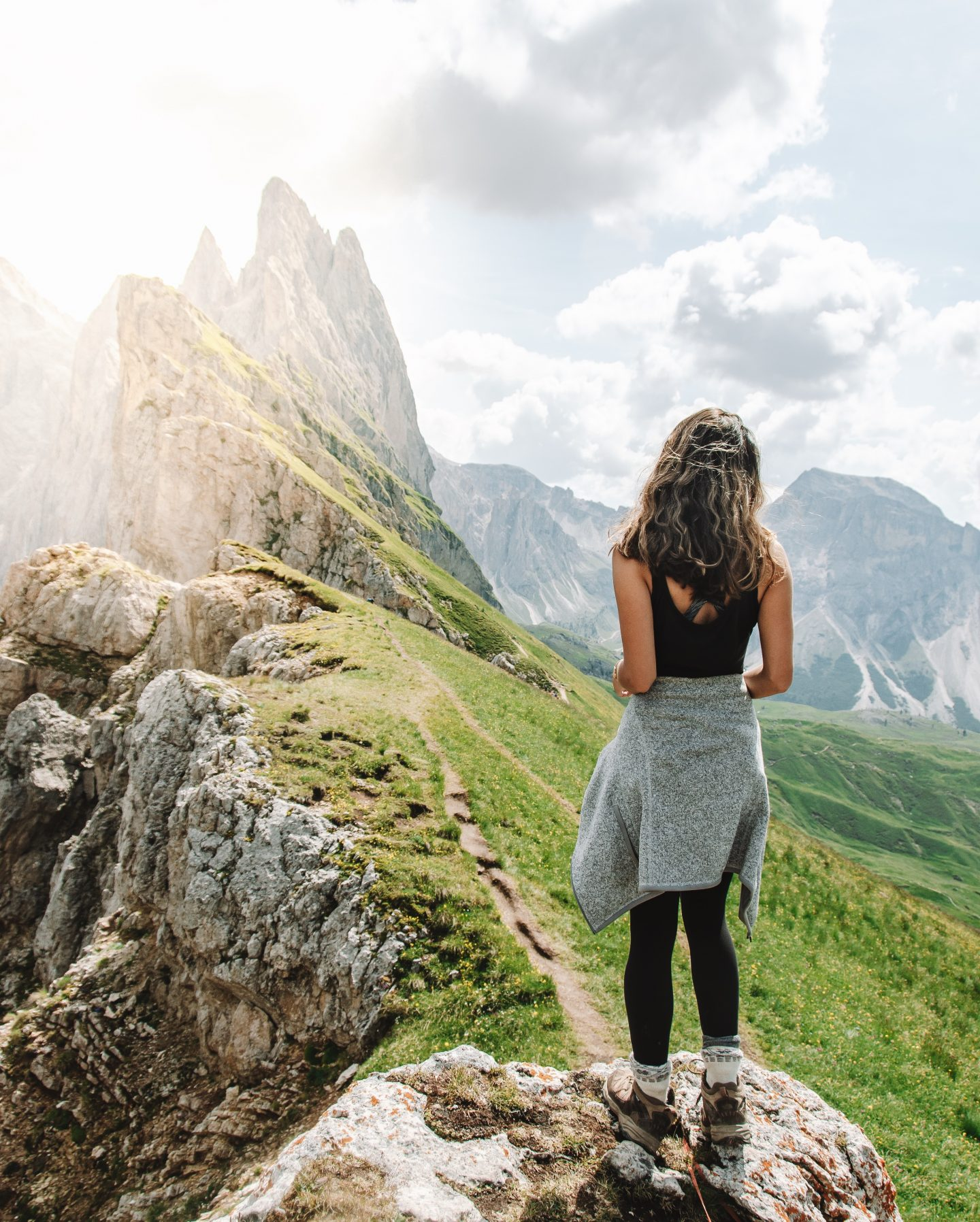Girl hiking on Seceda mountain in the Dolomites, Italy