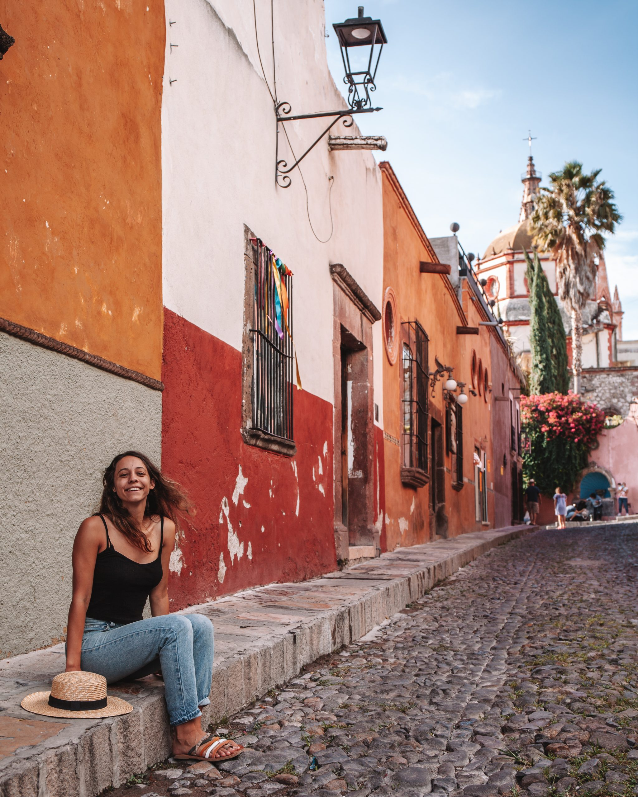 Girl sitting on the colorful street in mexico