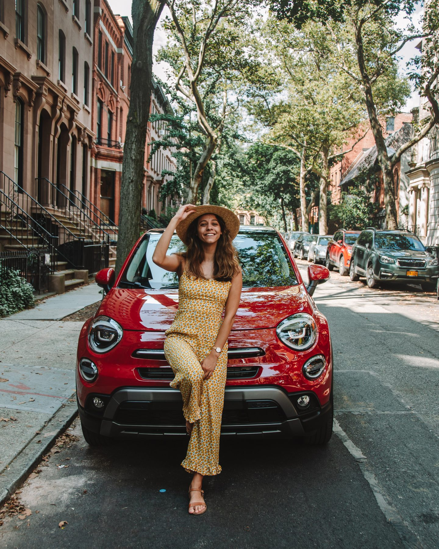 girl with red fiat on a charming street in Brooklyn Heights
