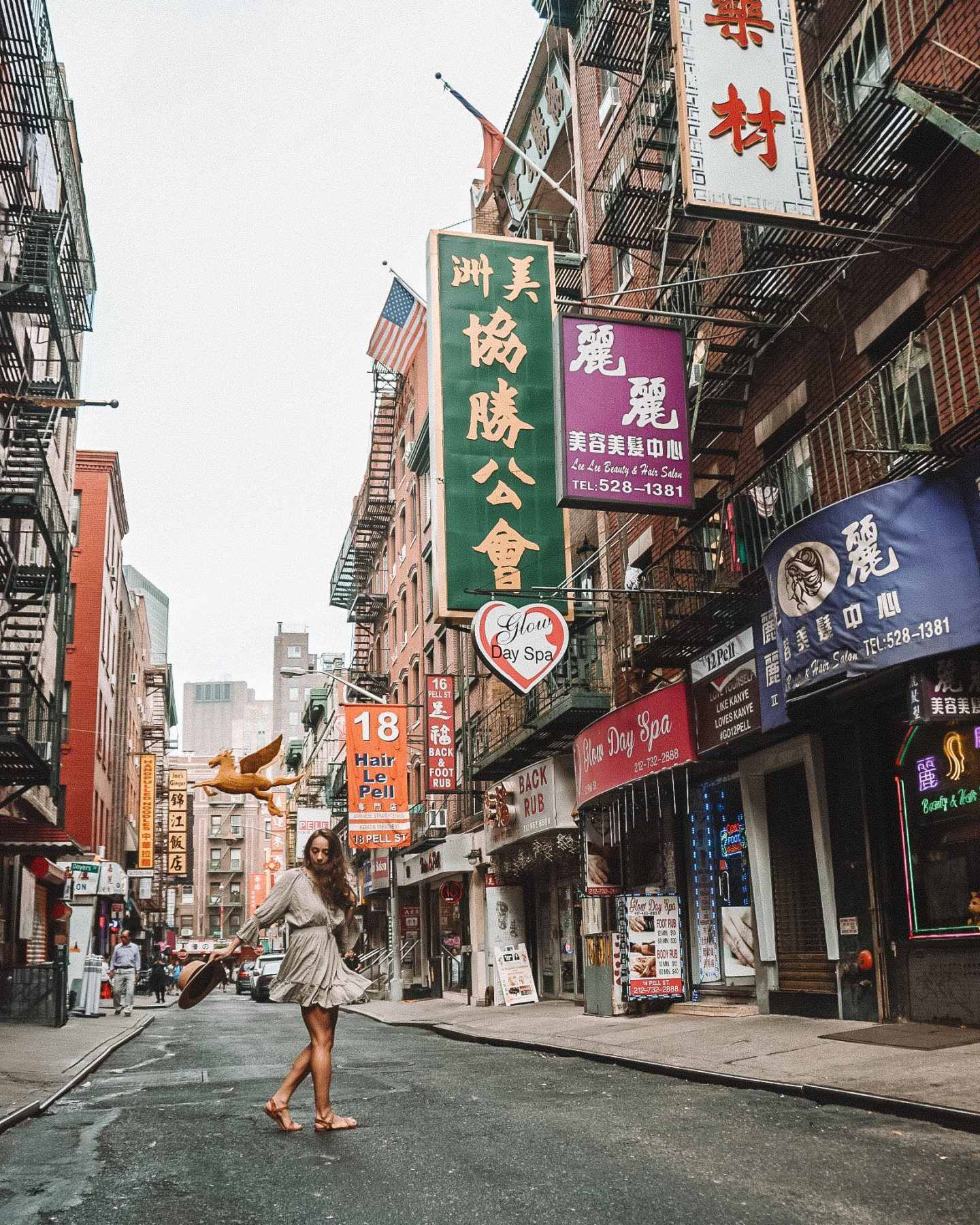 Girl in the street in Chinatown, NY