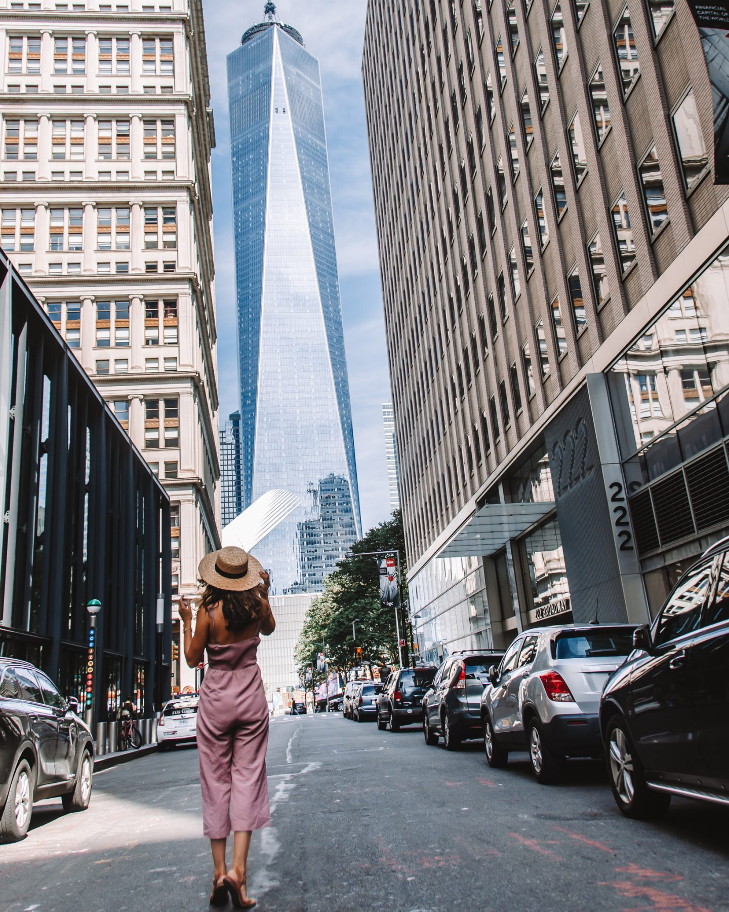 A girl posing in front of the Freedom Tower