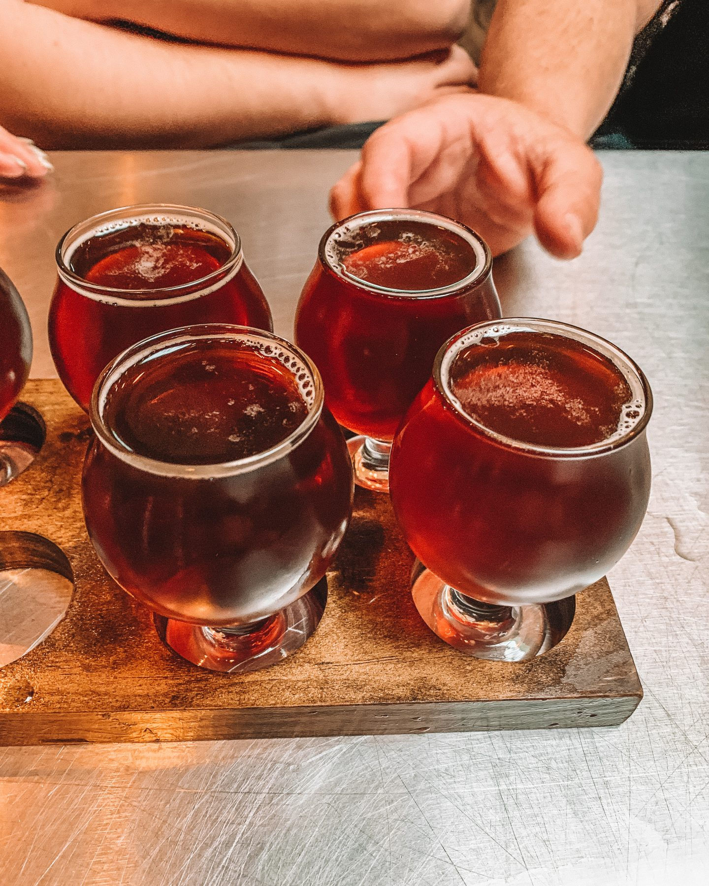 Four beers on a tray for a brewery tour in Long Island City, NY