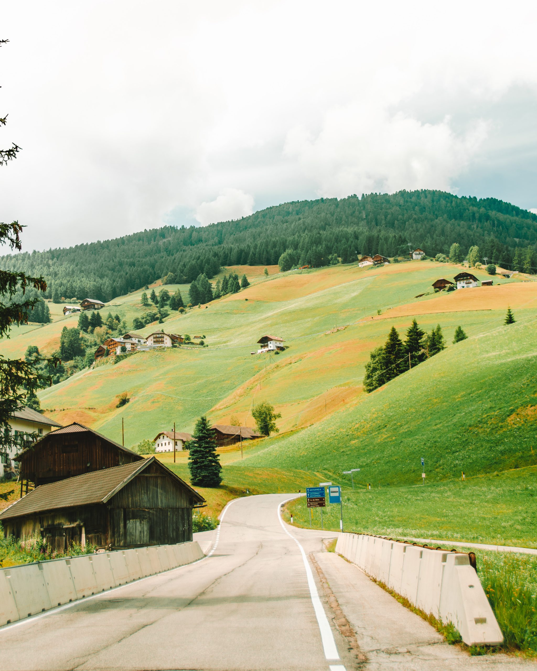 Rolling green hills on a road trip in the Dolomites, Italy