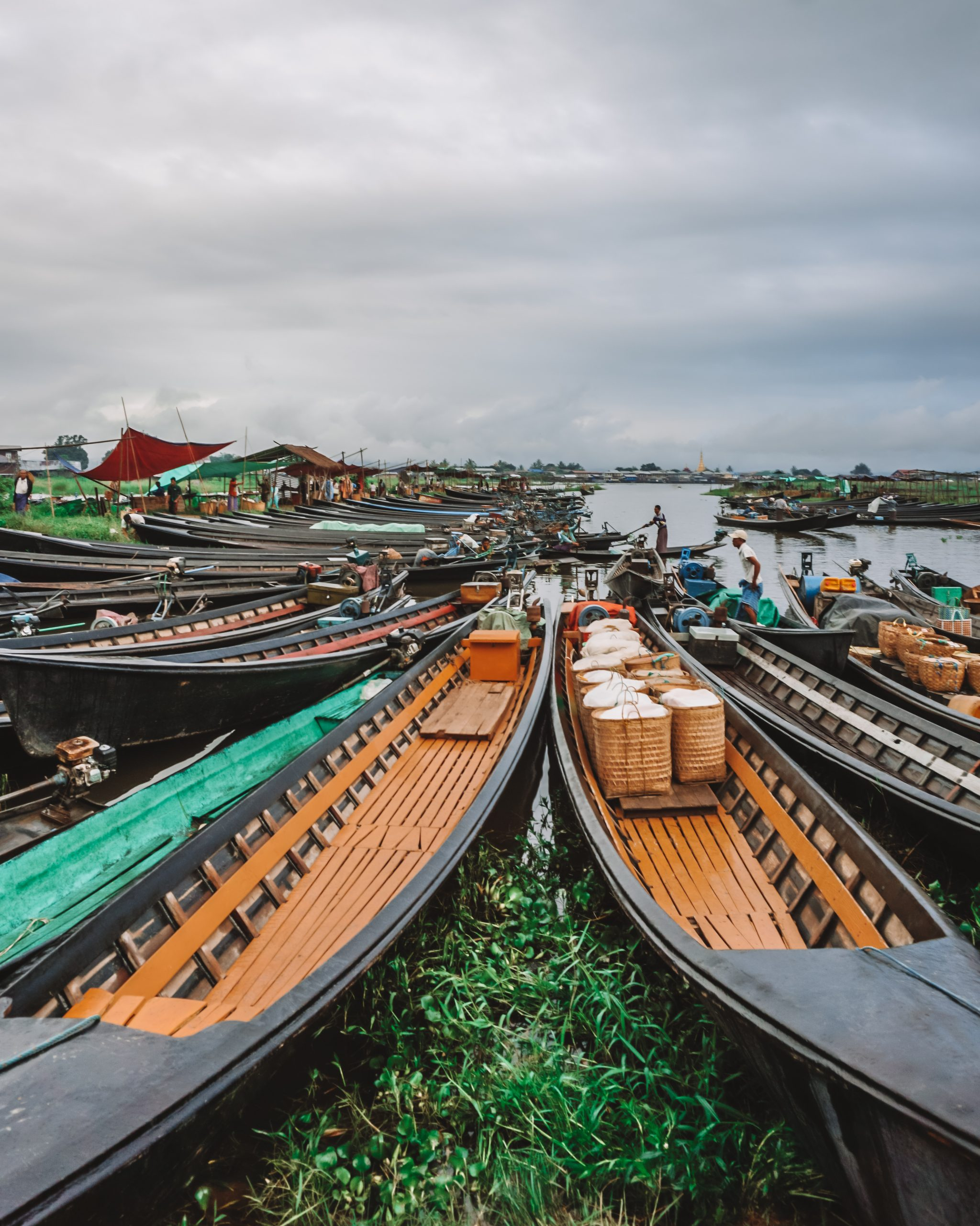 boats parked at the five day market in inle lake myanmar