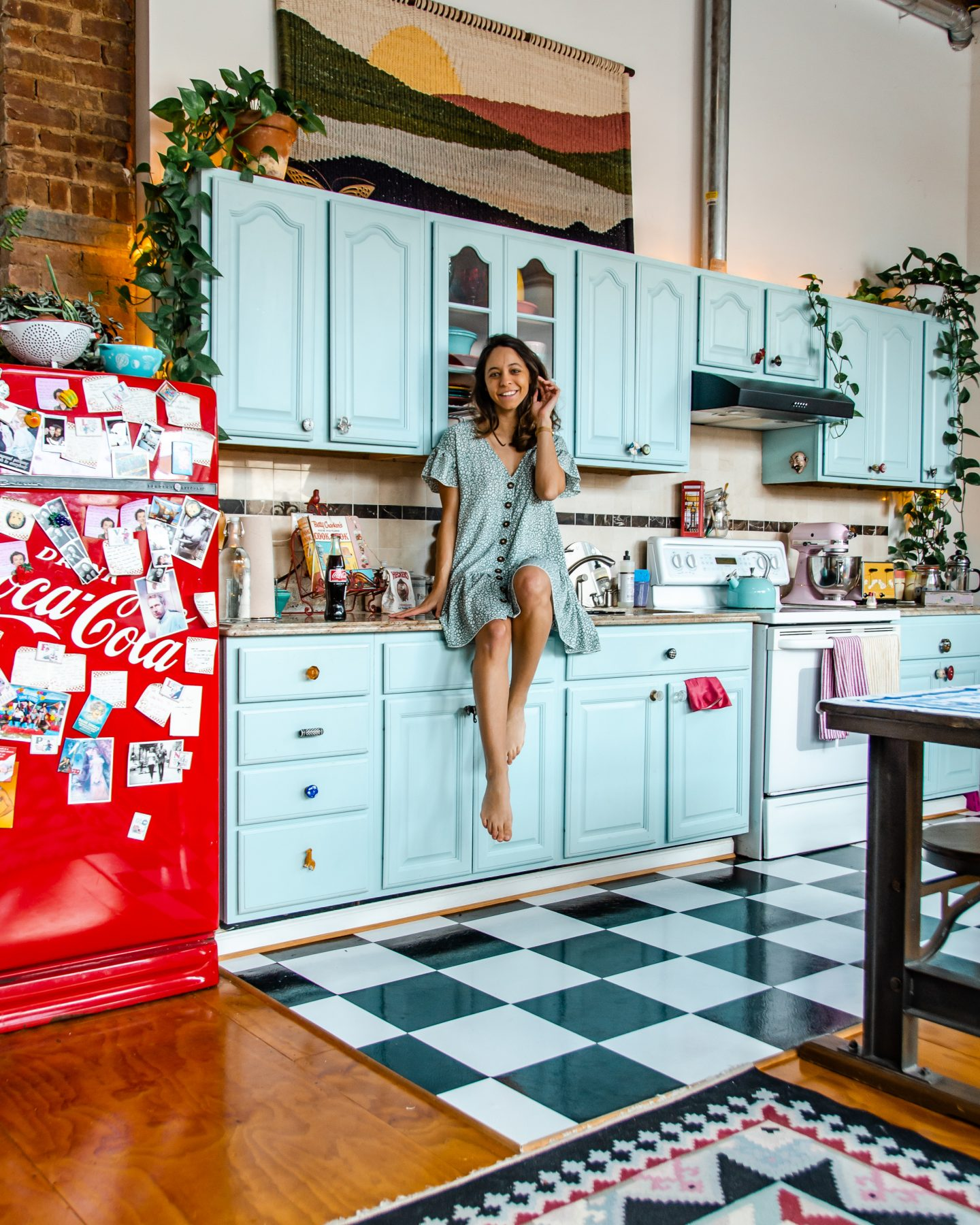 girl in the funky loft kitchen