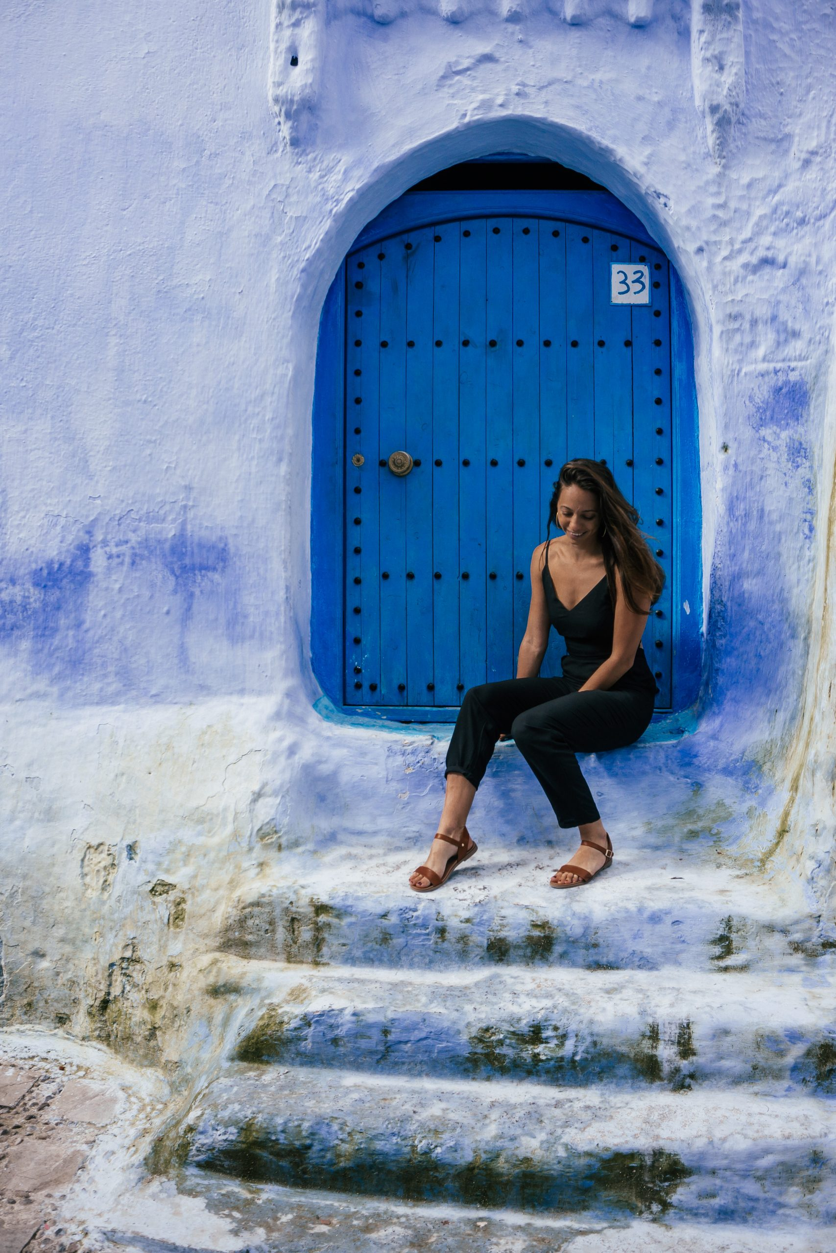 girl in black jumpsuit exploring the best things to do in chefchaouen morocco itinerary