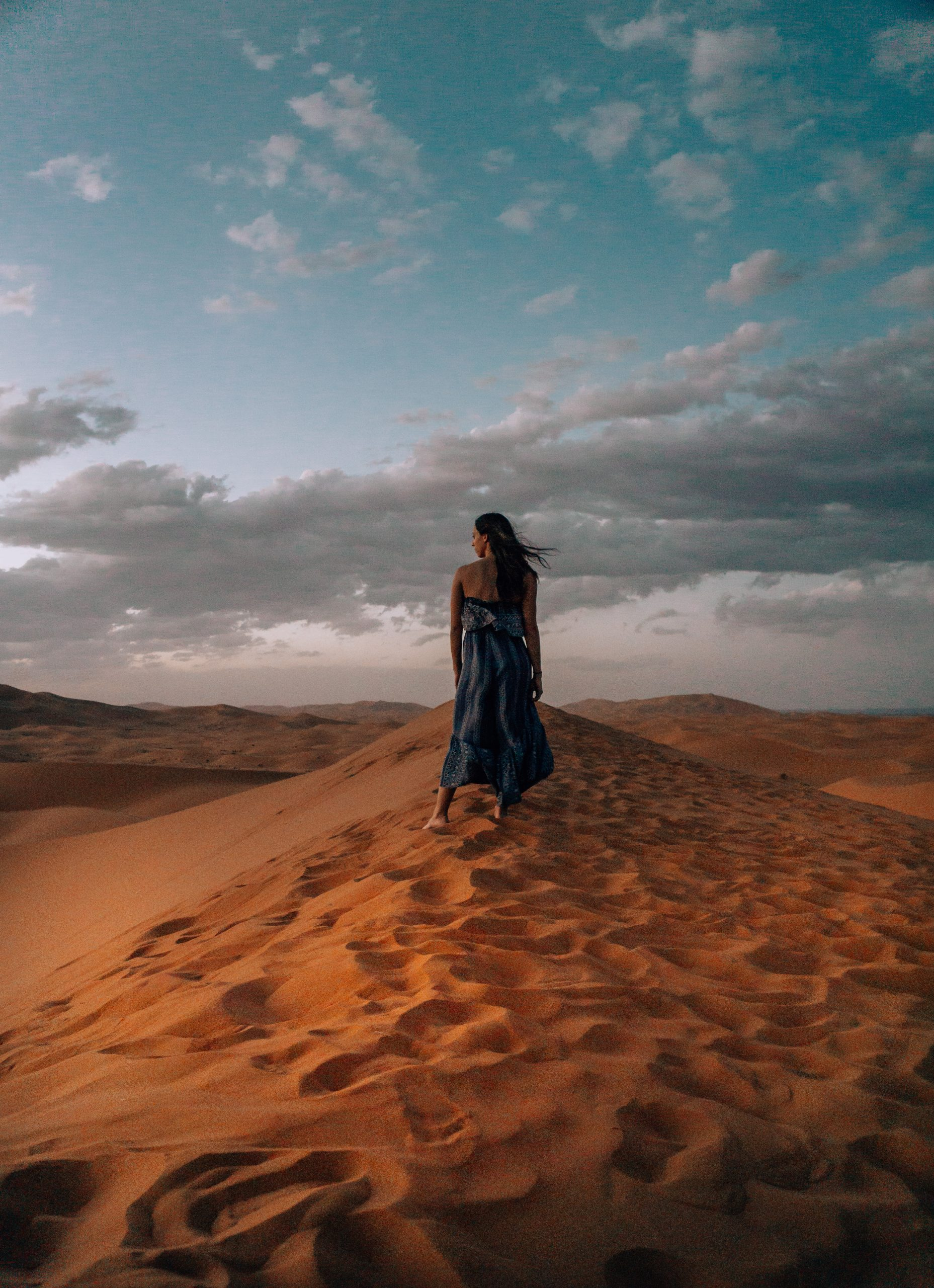 girl in blue dress in sahara desert morocco itinerary