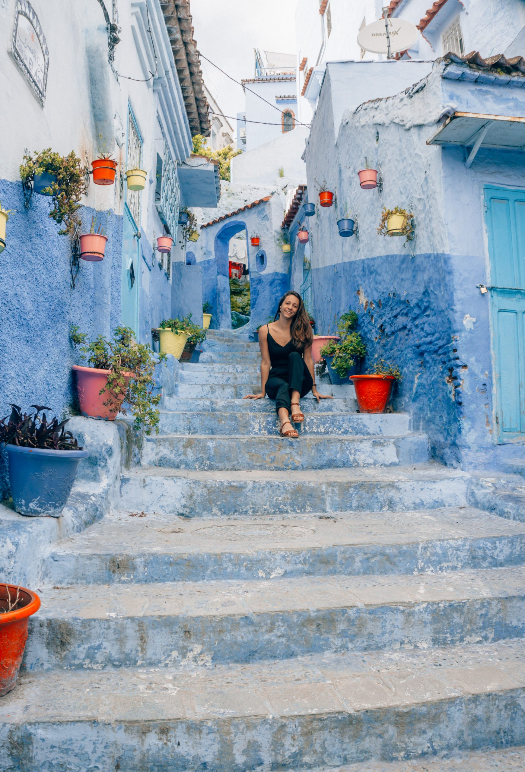 girl in black jumpsuit exploring the best things to do in chefchaouen morocco