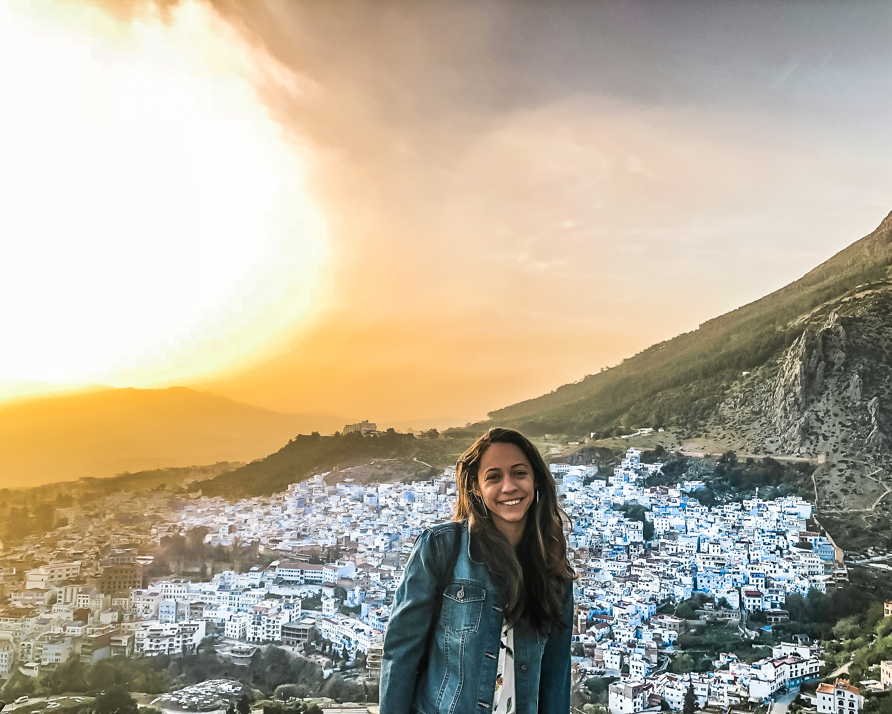 girl at spanish church in chefchaouen at sunset