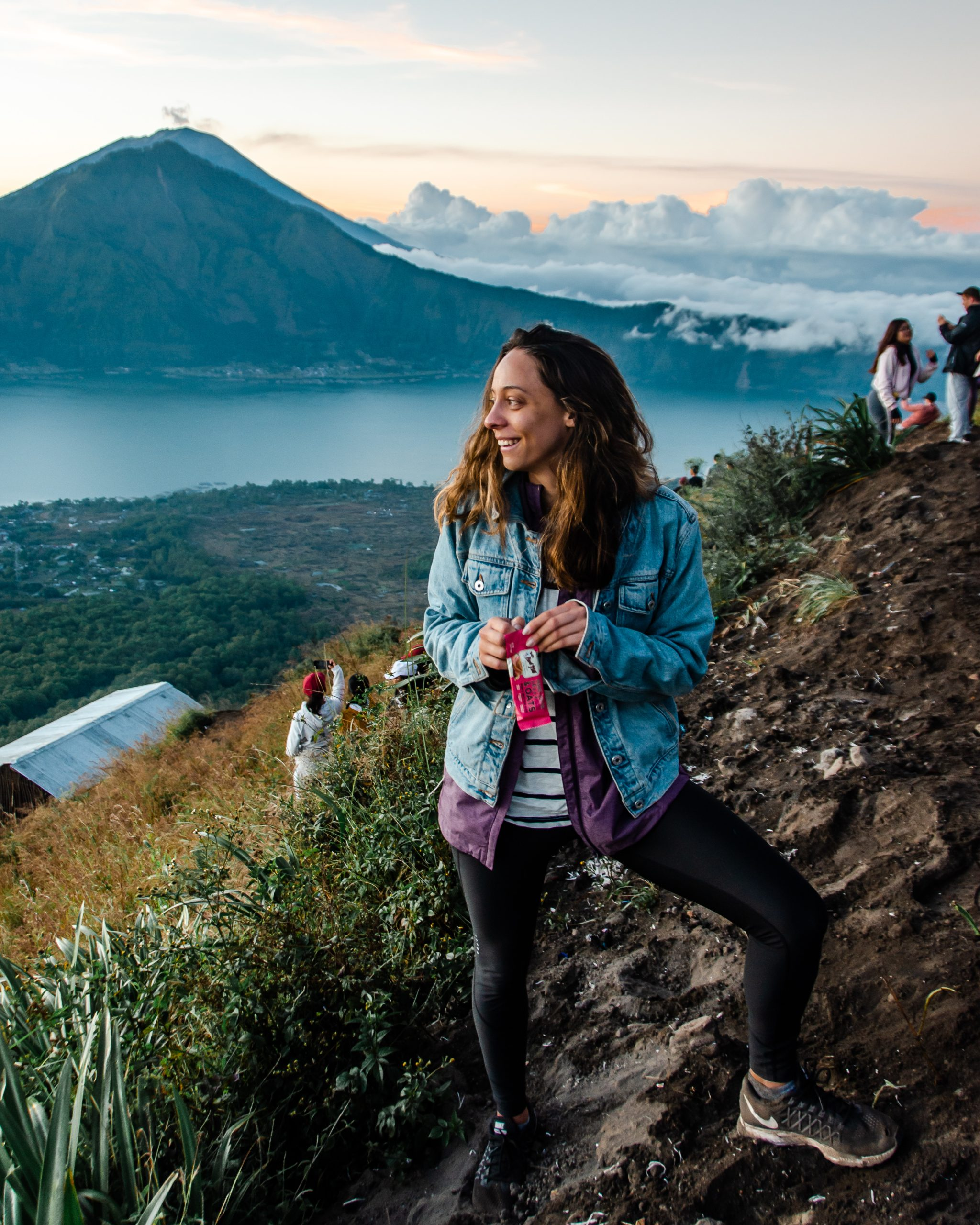 girl in jean jacket on mt batur sunrise hike