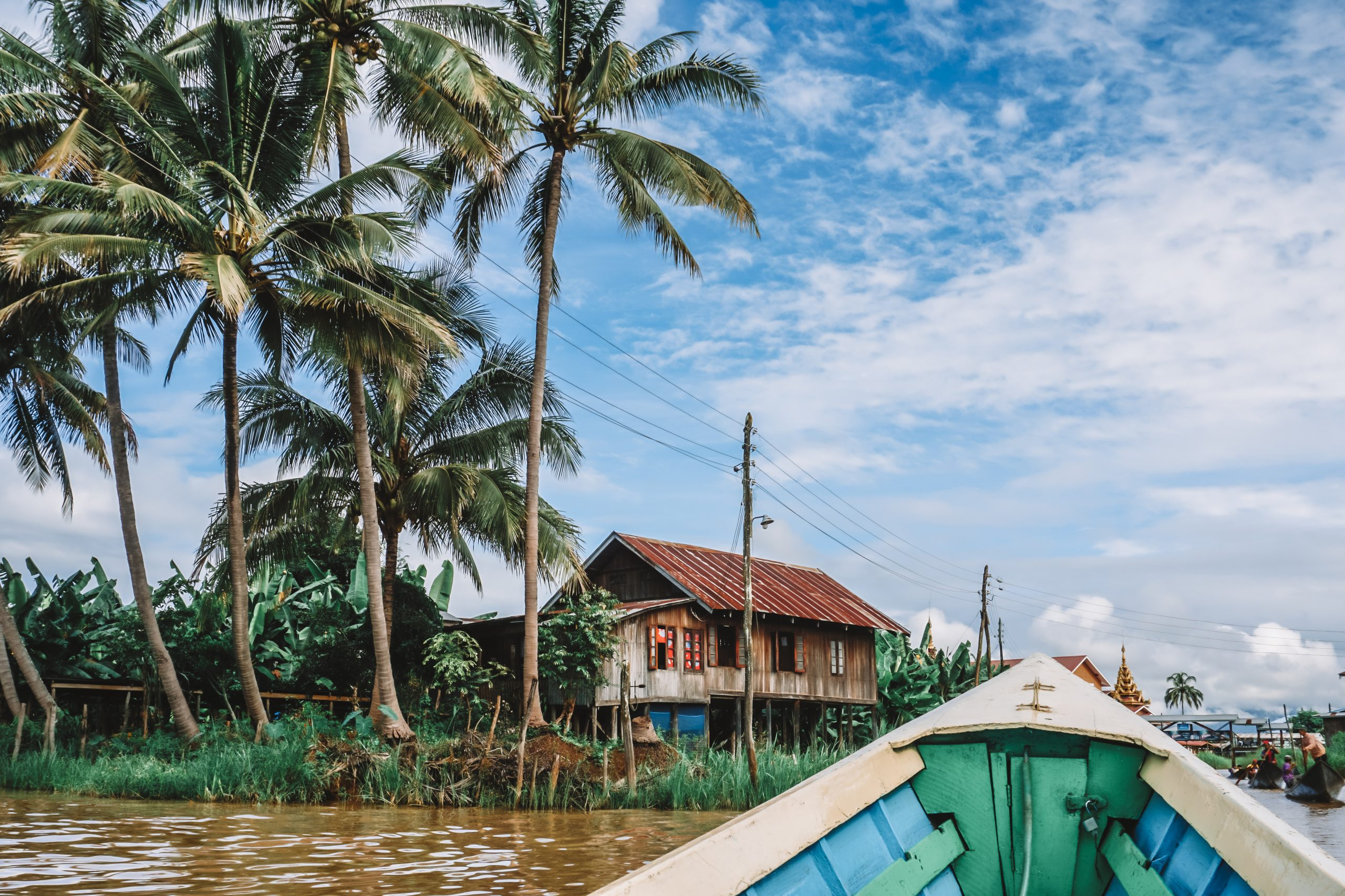 one of the best things to do in inle lake myanmar - a boat tour