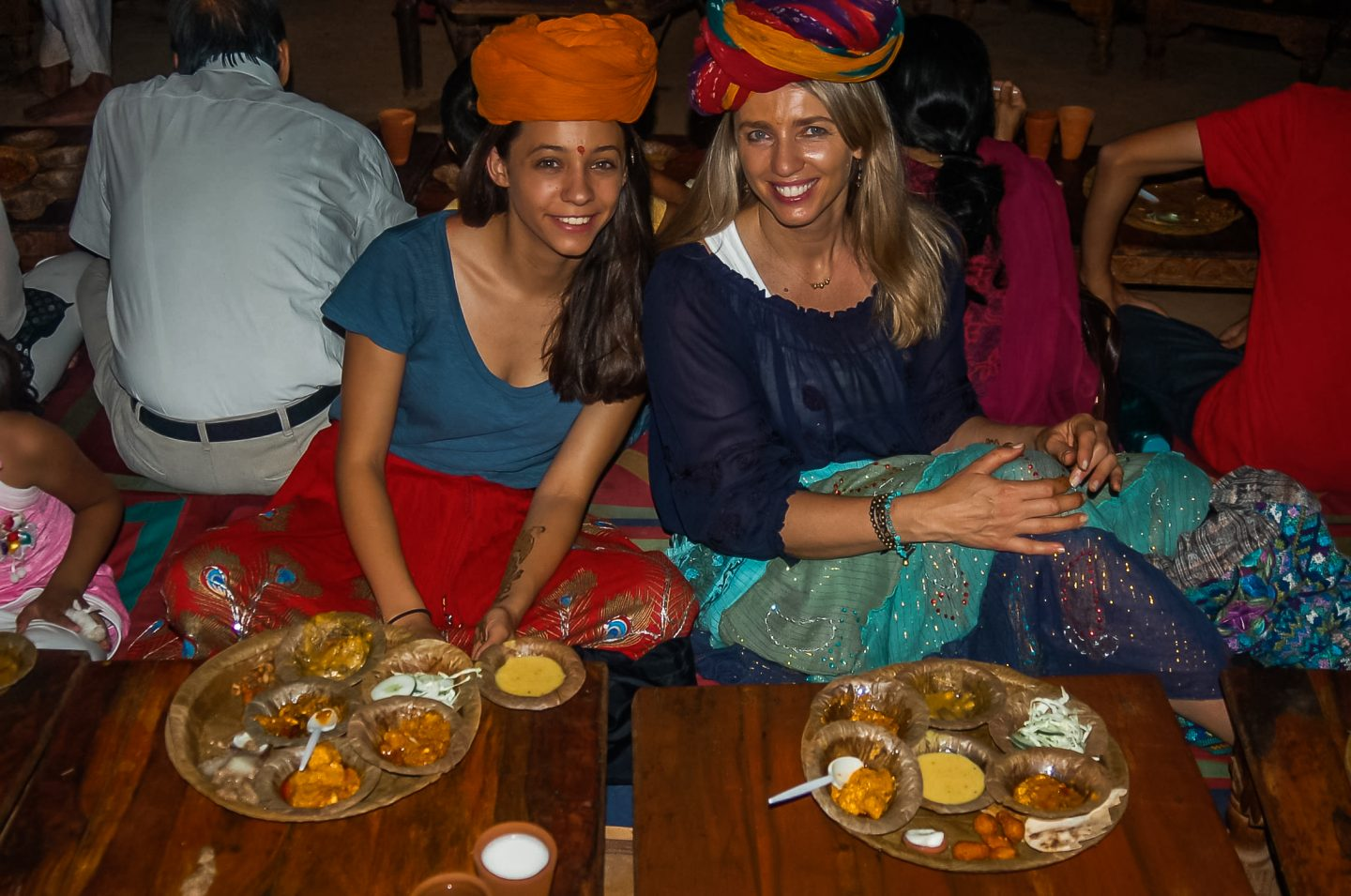 mother and daughter eating local food in india