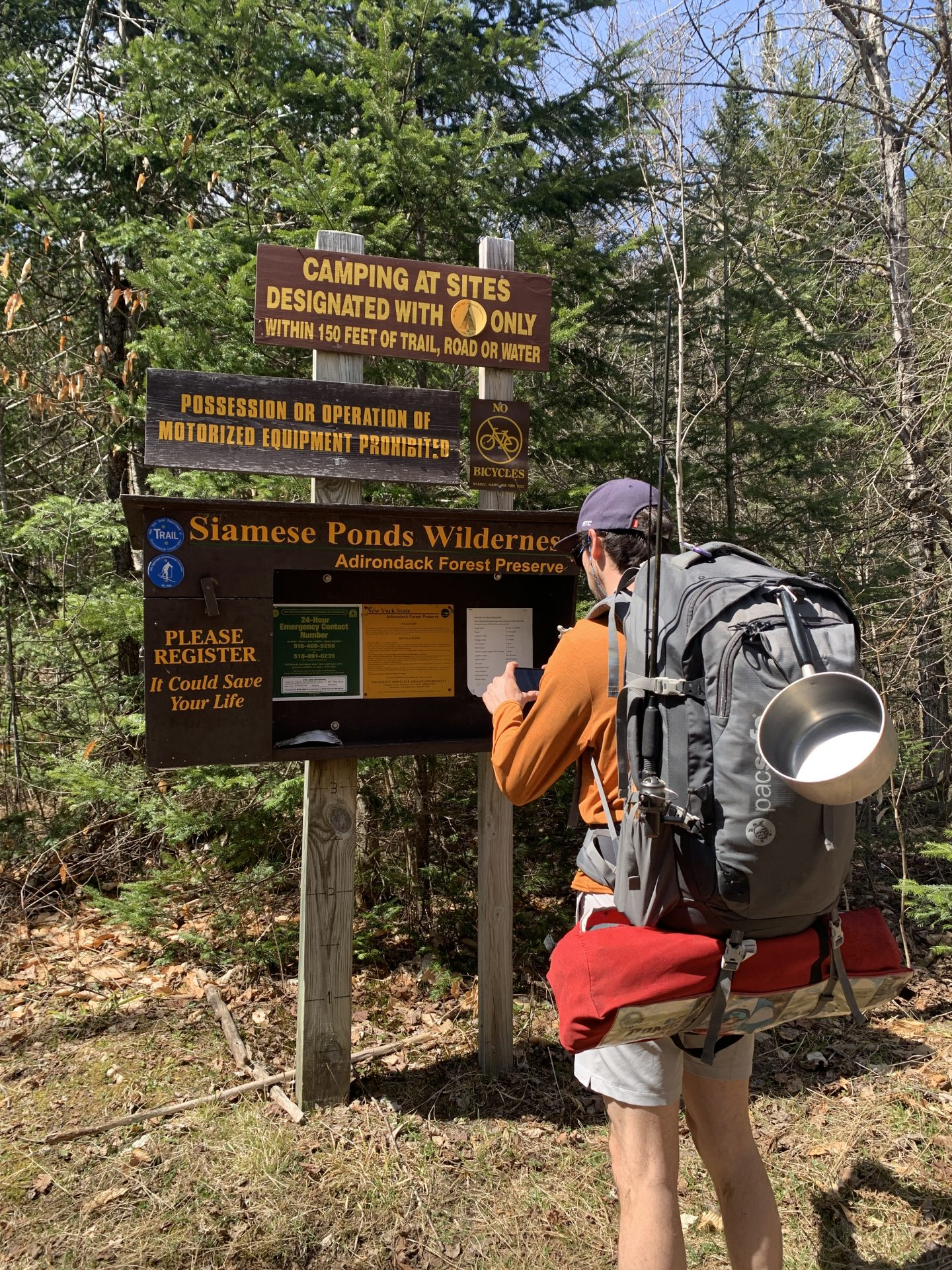 guy signing into the trail at siamese ponds wilderness in the adirondacks
