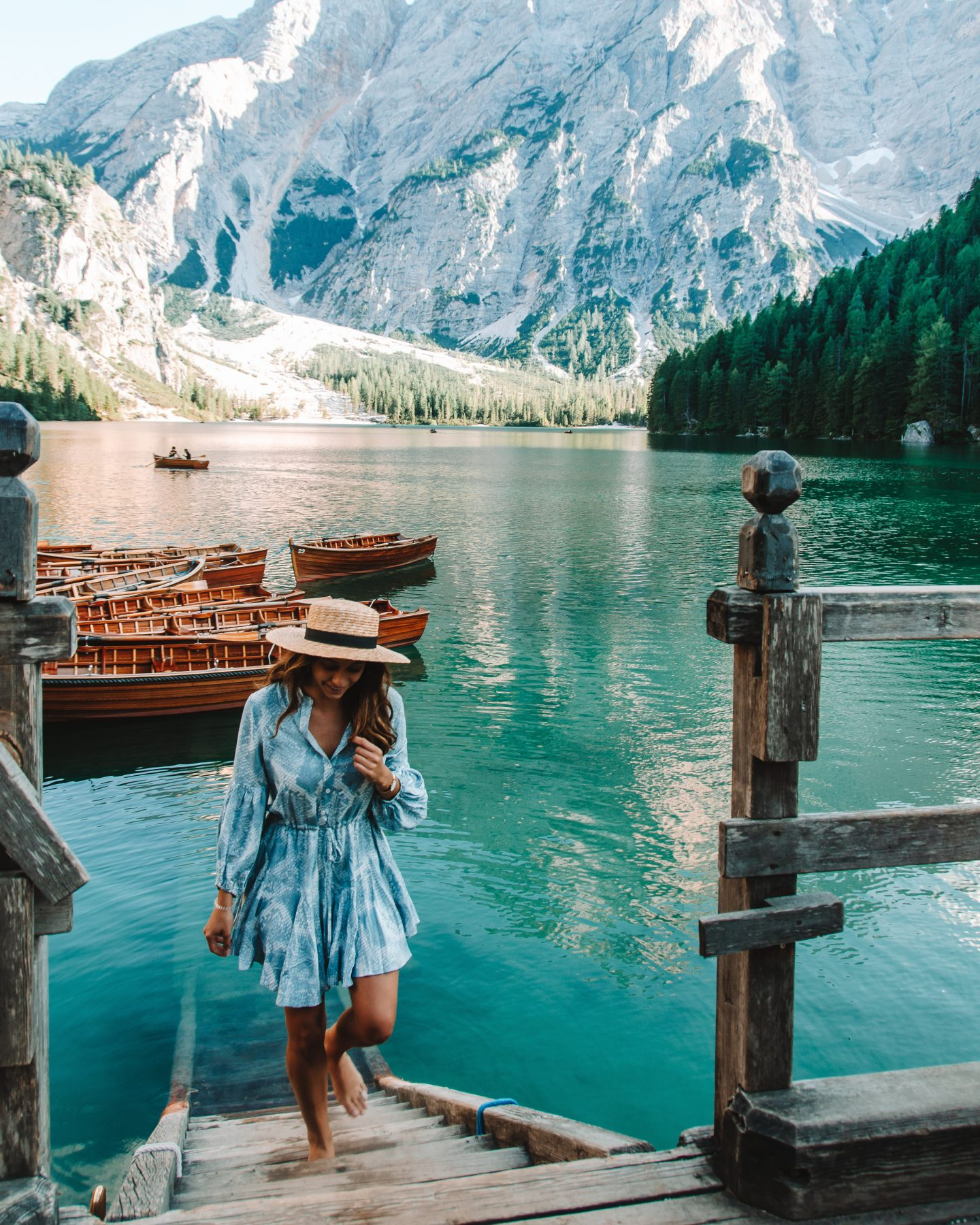 lago di braies and girl with blue dress