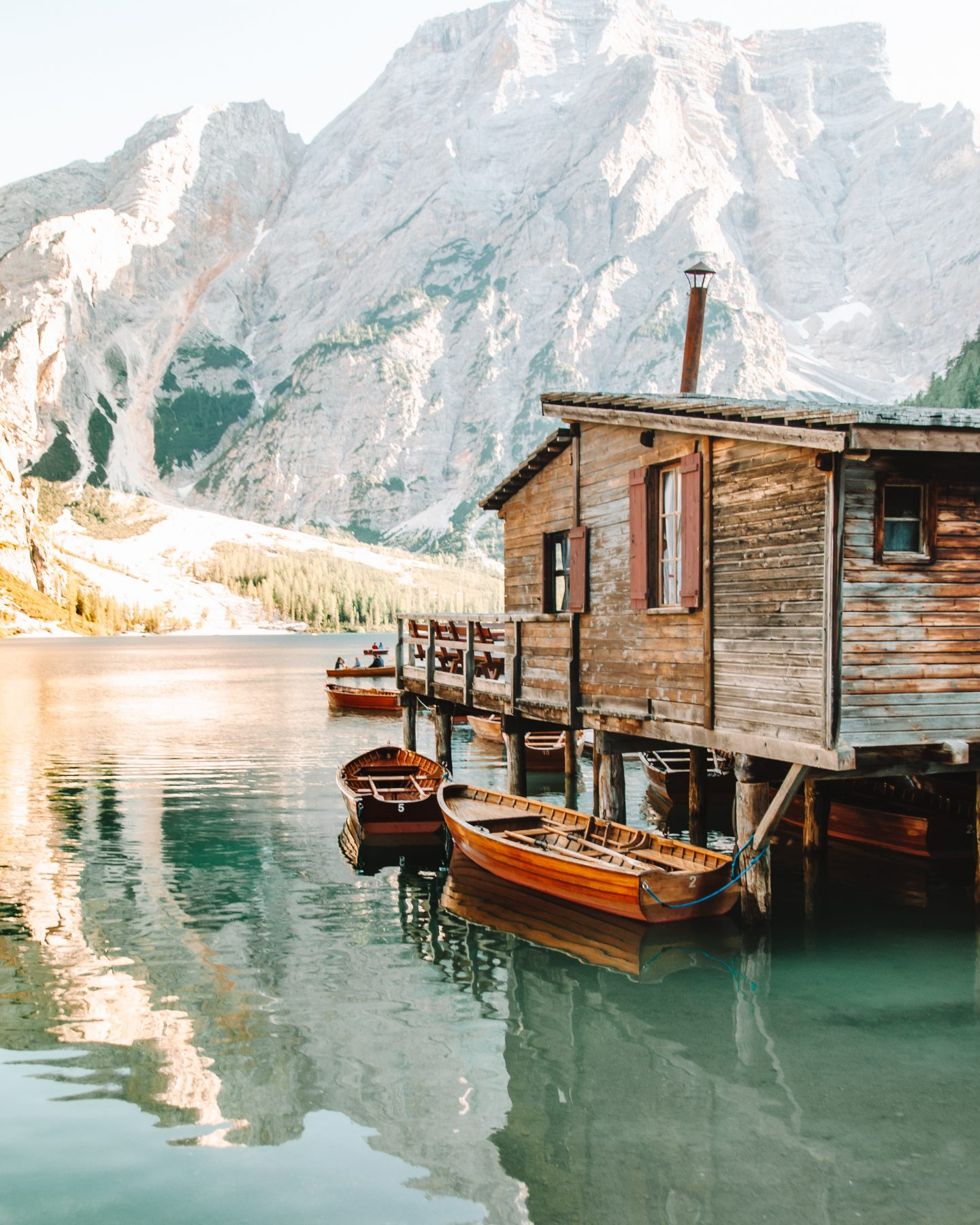 the boathouse at lago di braies in the dolomites