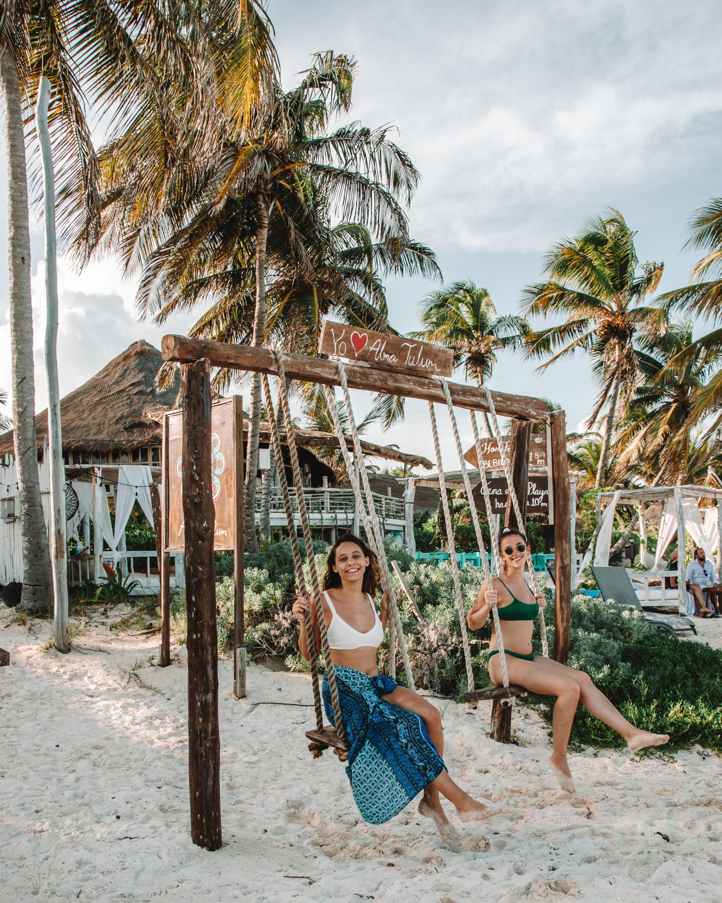 two girls on swings in tulum mexico