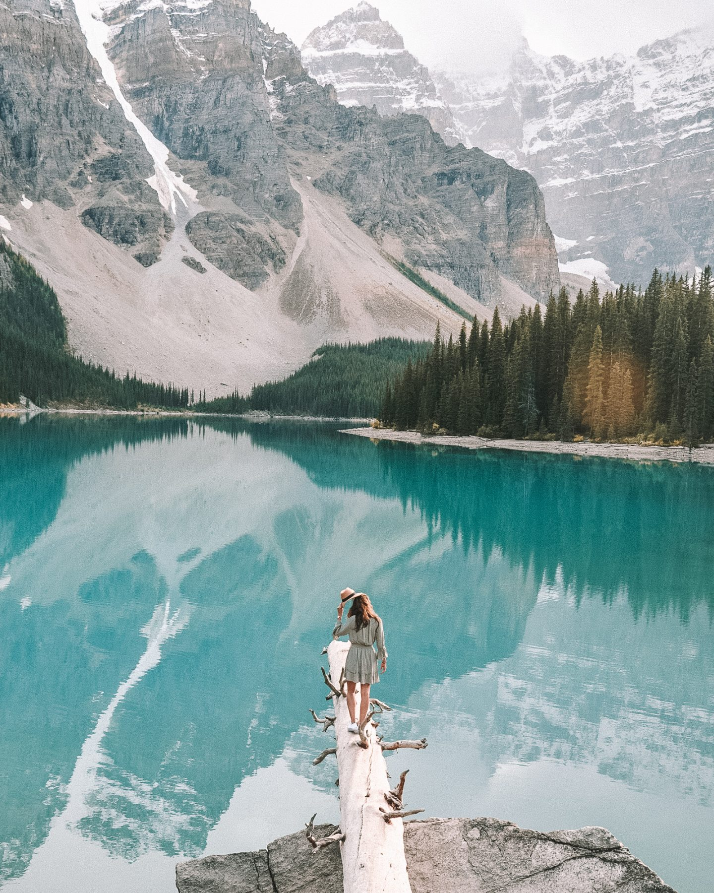 girl on log at moraine lake banff national park canada