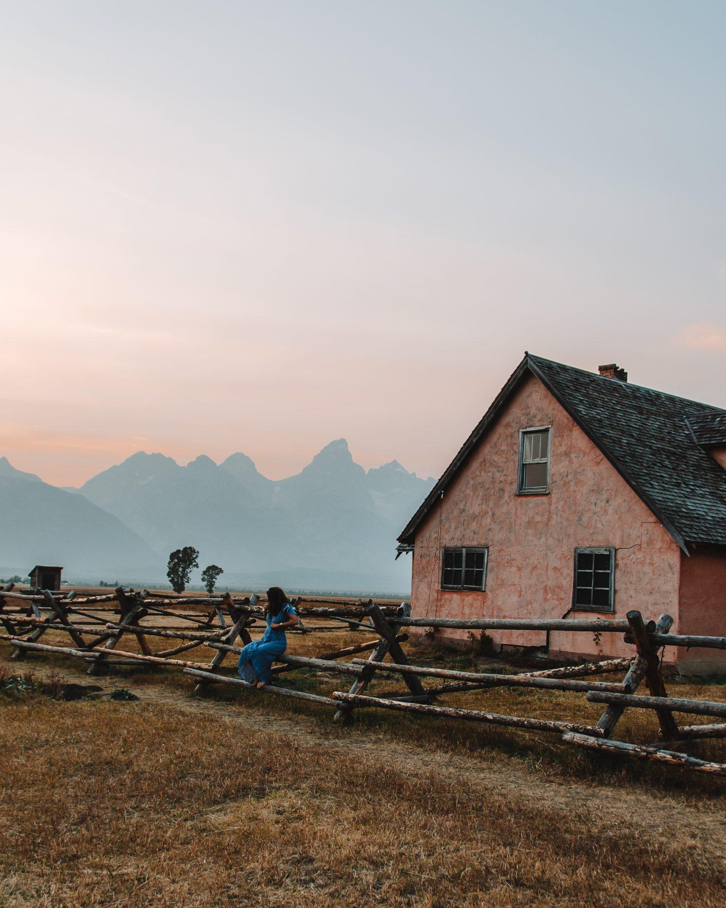 mormon row at sunset with girl
