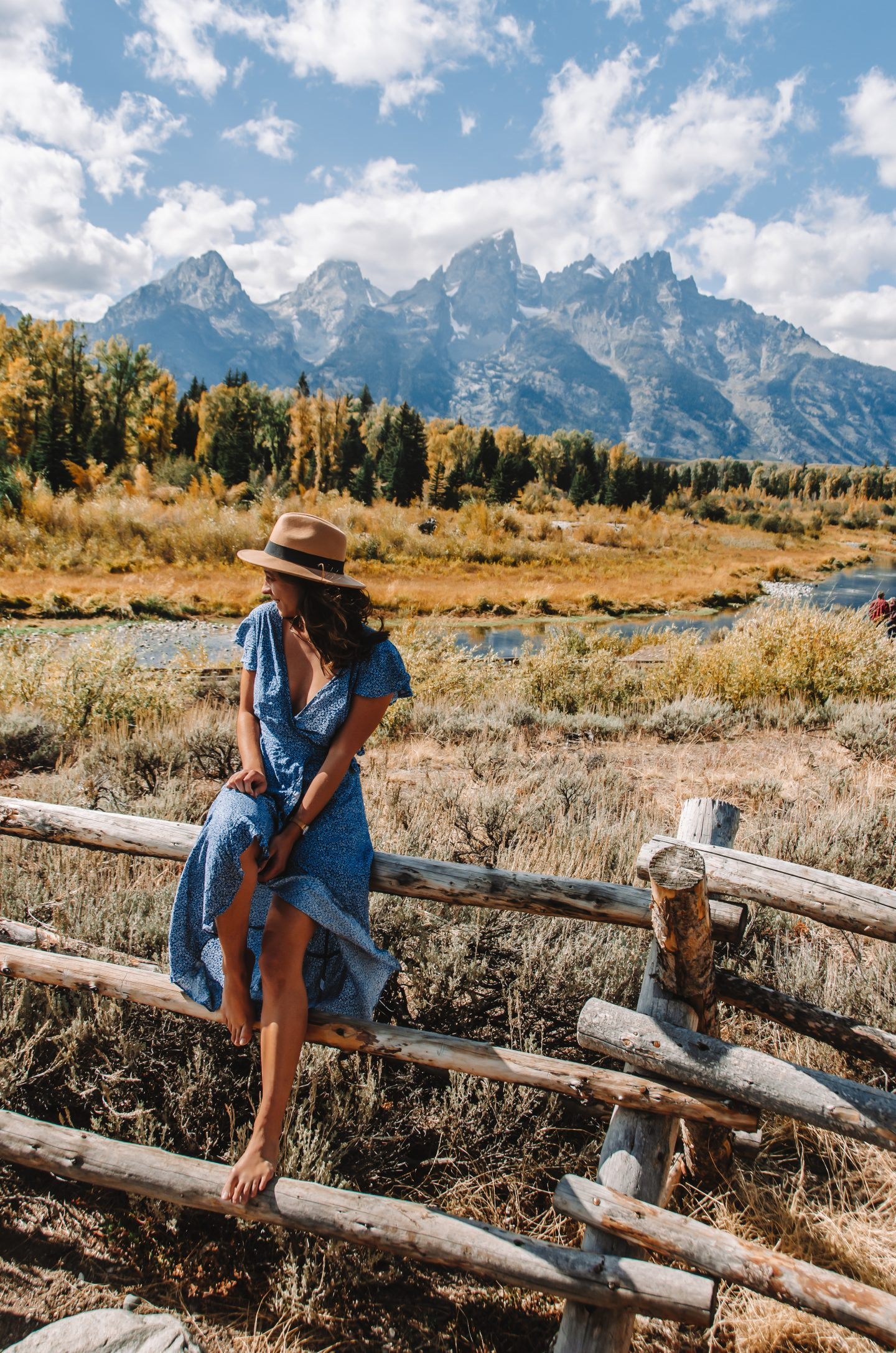 girl in blue dress with mountains in background