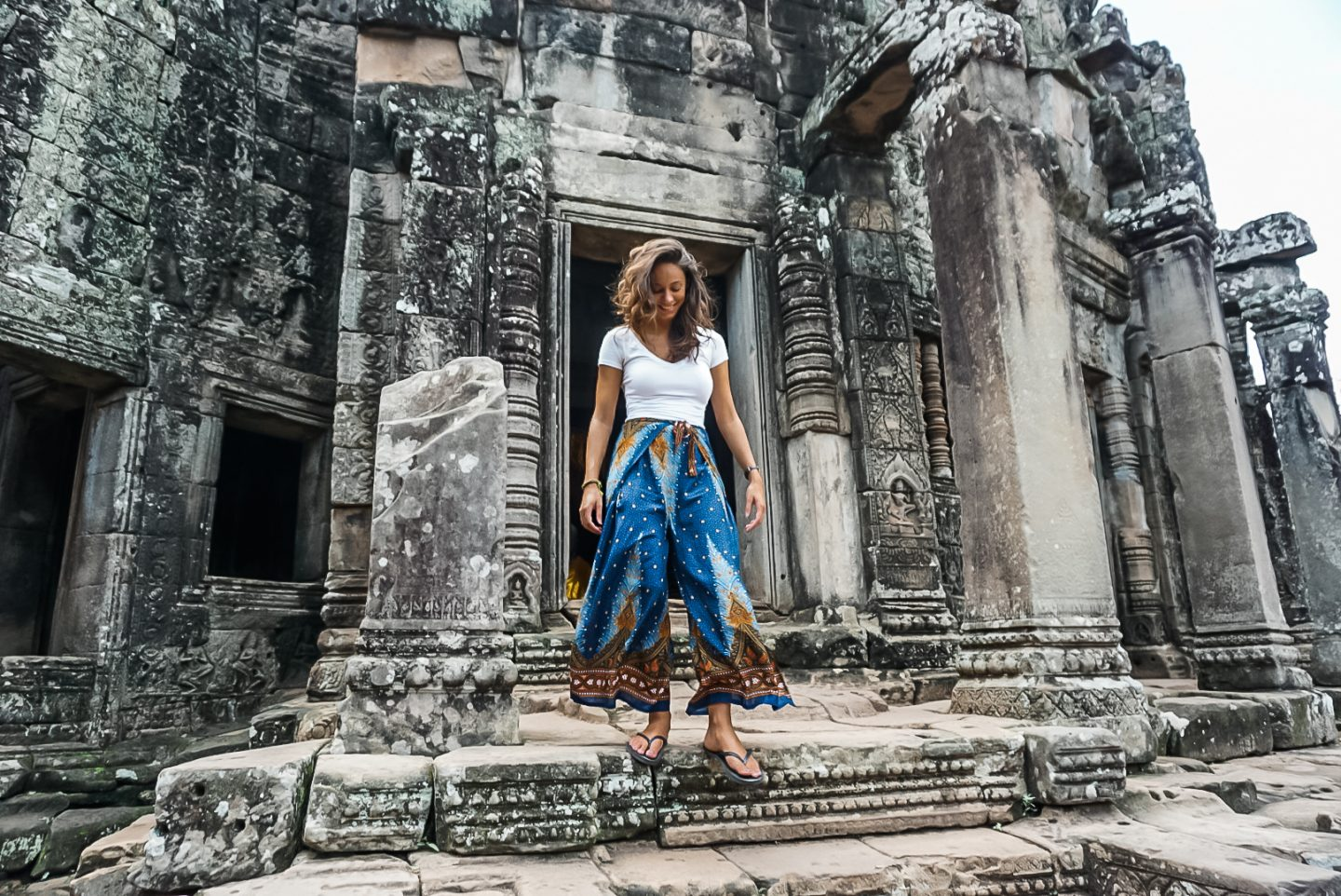 solo female traveler at a temple in cambodia