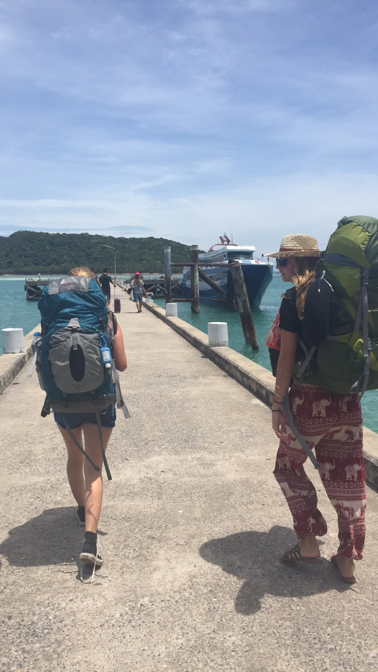 two girls in thailand with backpacker backpacks