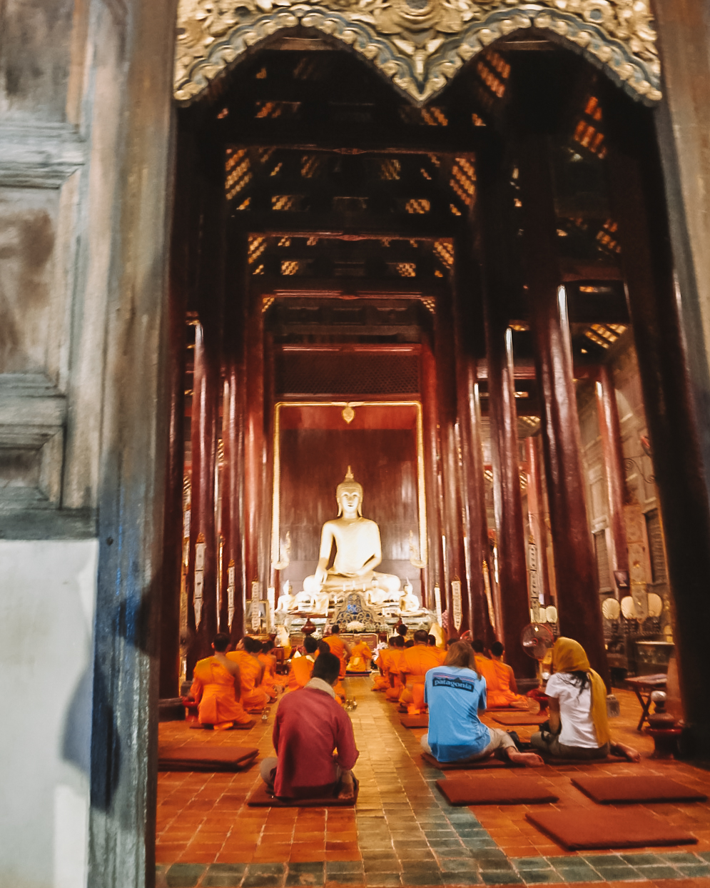 monks praying in a temple in  chiang mai thailand