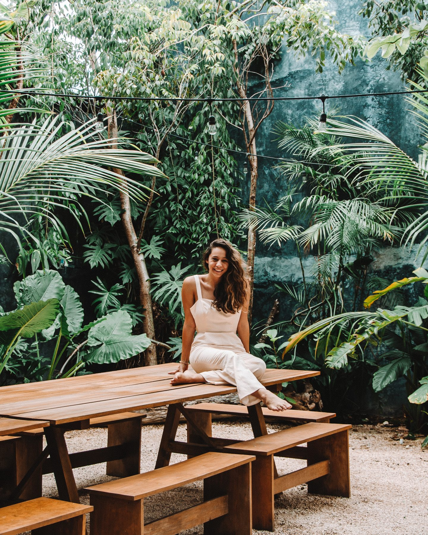 what to know about tulum solo travel - girl sitting on bench