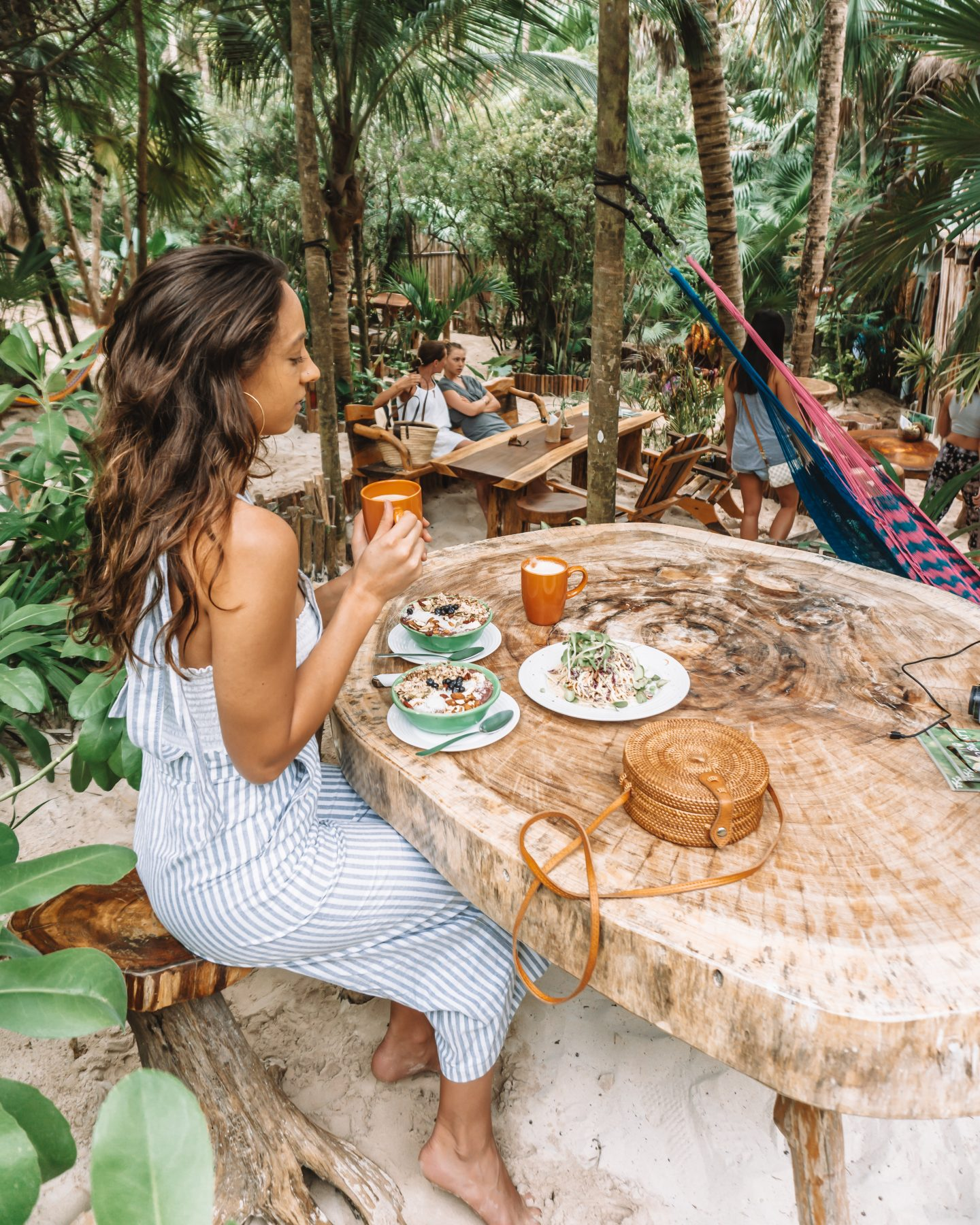 girl eating at raw love in tulum mexico