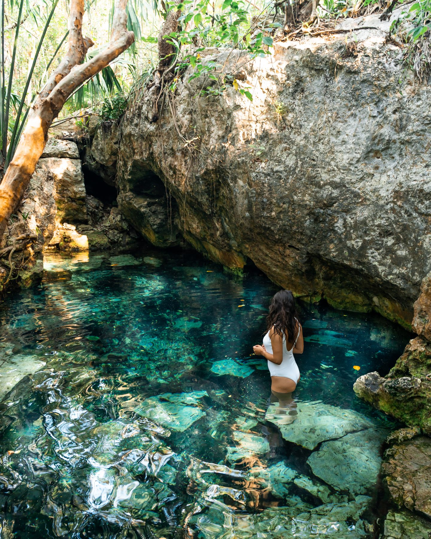 girl swimming at cenotes in mexico