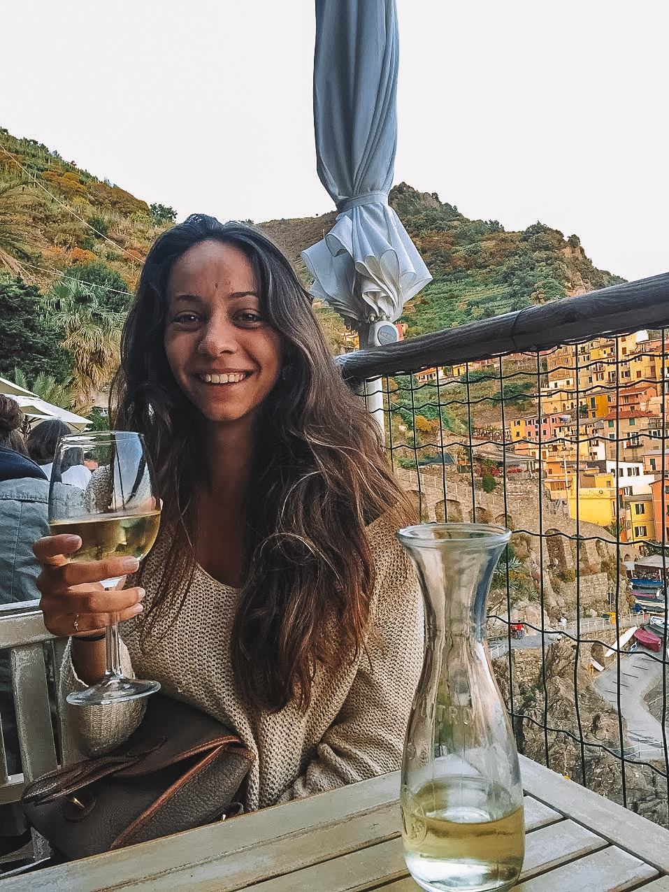 girl drinking wine in cinque terre italy
