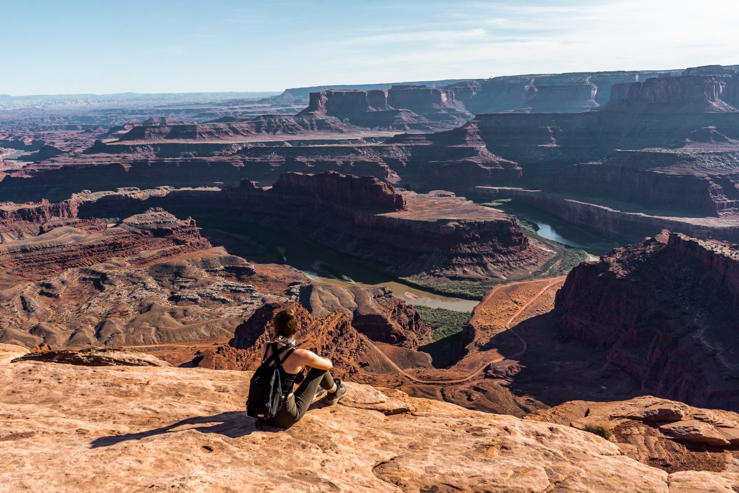 girl sitting at overlook at Dead Horse Point State Park